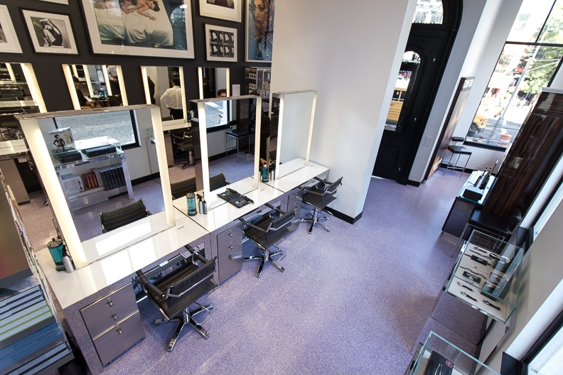 Beauty stations and an overhead view of display cases, photographs, and the entrance of John Barrett Salon in New York. MEP provided by 2L Engineering.