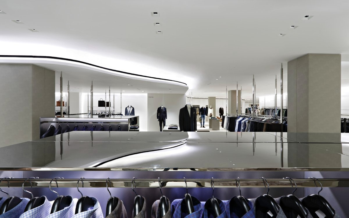 Looking over a display rack with dress shirts to view the menswear section at Barney's New York. MEP designed by 2L Engineering.