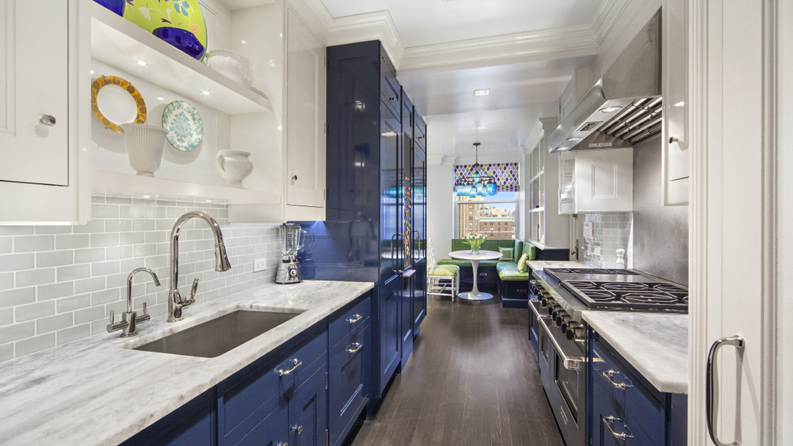 Kitchen with a breakfast nook and blue cabinets. MEP designed by 2L Engineering.