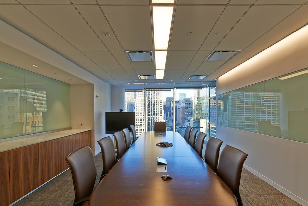 Private conference room table with white boards and a window overlooking the Manhattan skyline in the Wood Mackenzie offices. MEP designed by 2L Engineering.