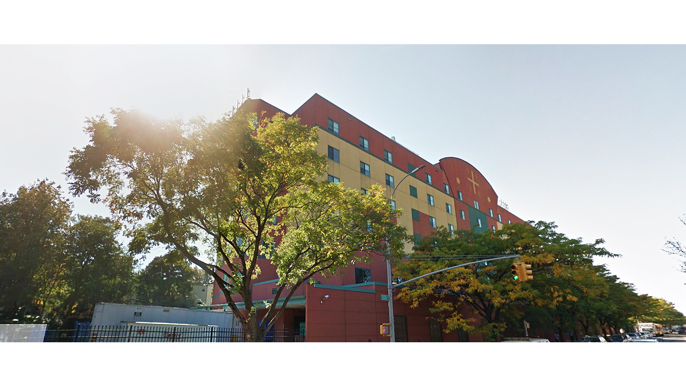Exterior view of the reddish walls of the Henry Bishop Nursing Home surrounded by trees in Brooklyn, New York. MEP designed by 2L Engineering.