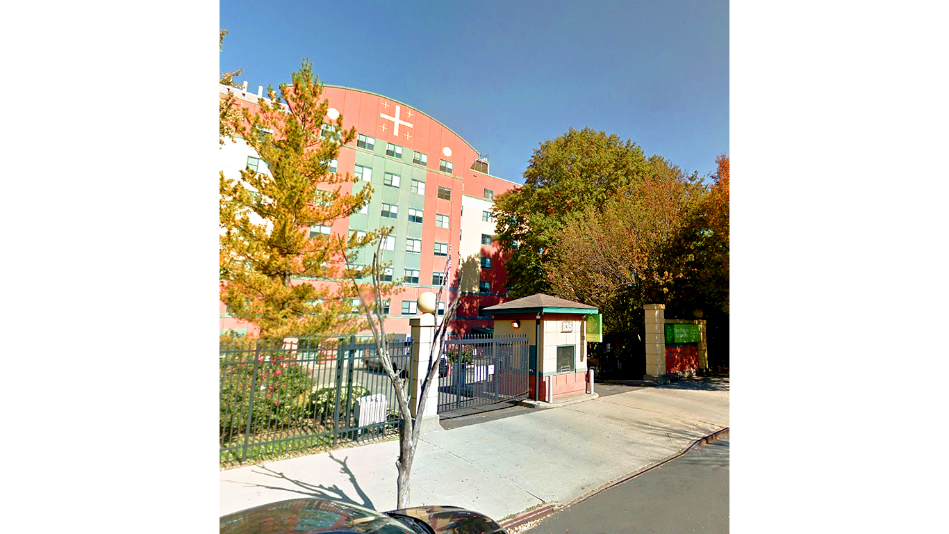 Parking entrance and facade view from the sidewalk of the Henry Bishop Nursing Home in Brooklyn, New York. MEP provided by 2L Engineering.