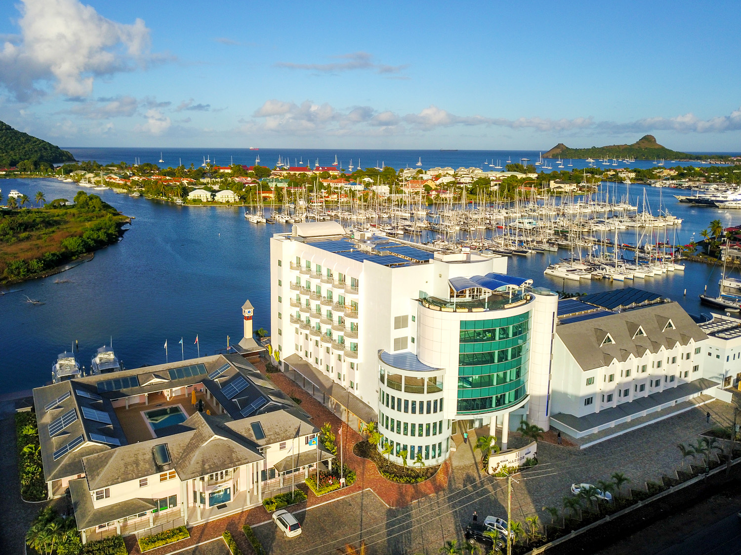 Front facade of the Harbot Club Hotel in St. Lucia overlooking the boats docked at the harbor. MEP designed by 2L Engineering.
