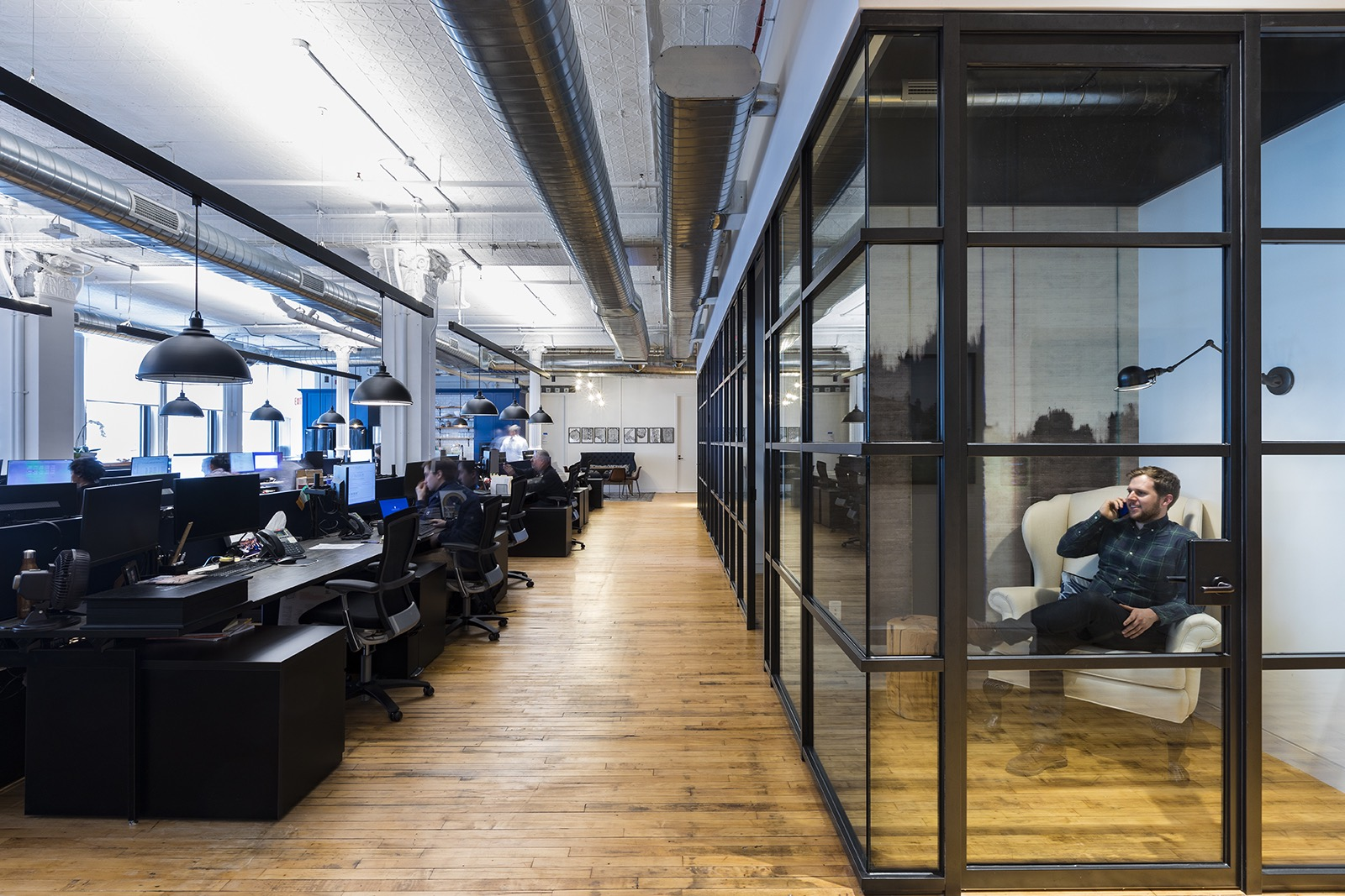 Working space and private phone booths with blue accent walls in the Edrington Spirits New York location. MEP designed by 2L Engineering.