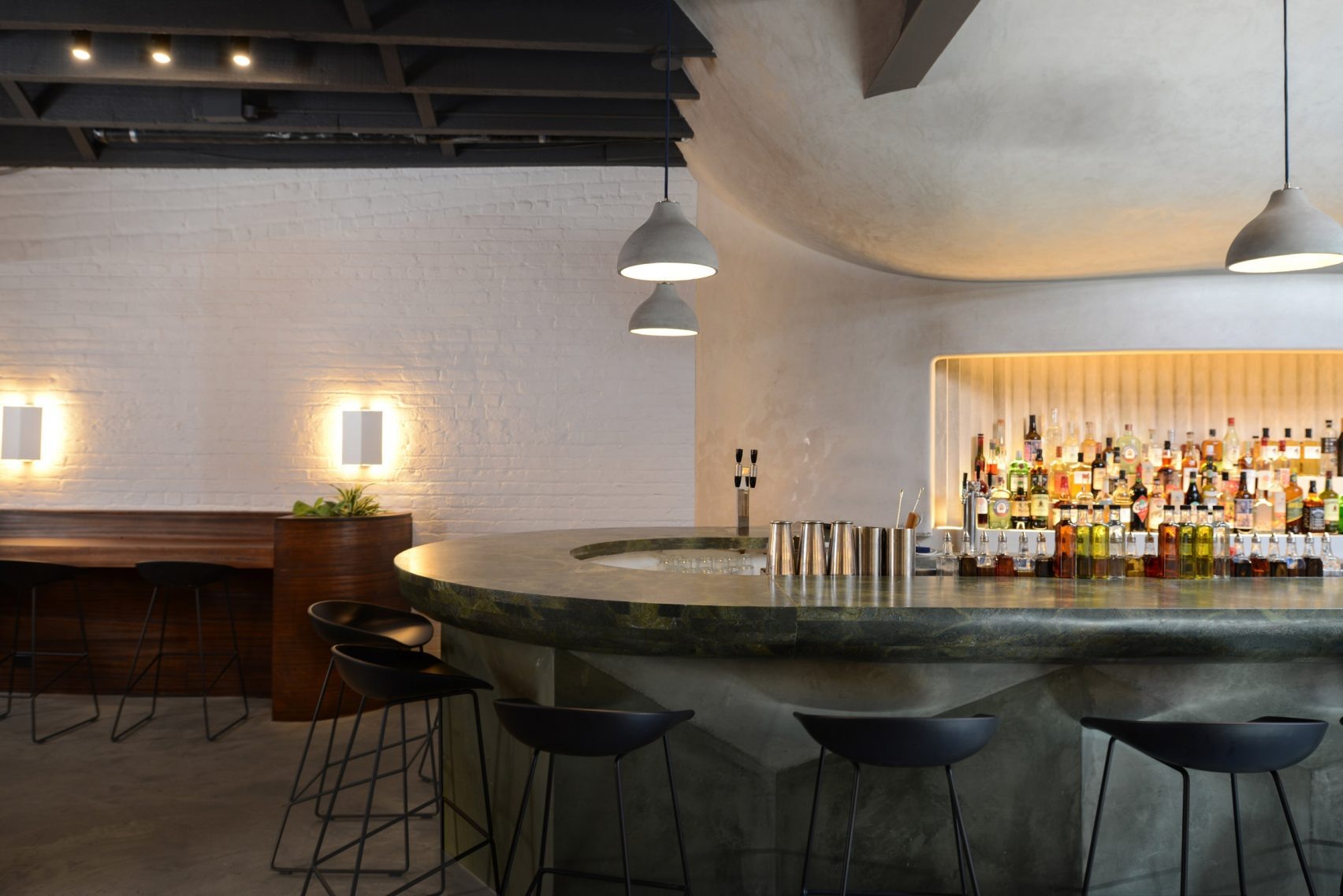 Corner view of the bar at Bar Beau, a bar and coffee shop with MEP design services provided by 2L Engineering
