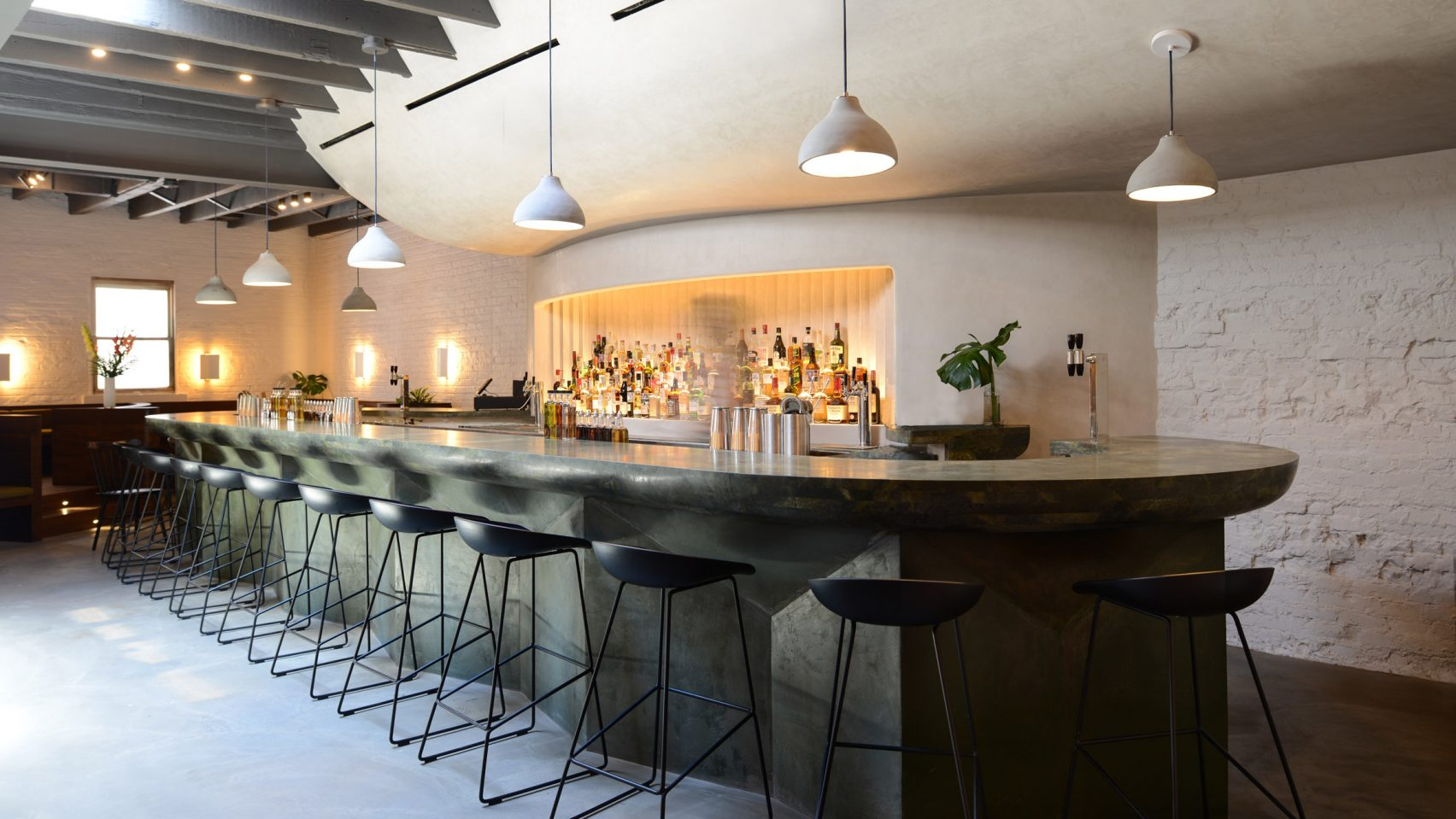 An interior look at the bar at Bar Beau, a coffee shop/bar located in Brooklyn with MEP design services provided by 2L Engineering