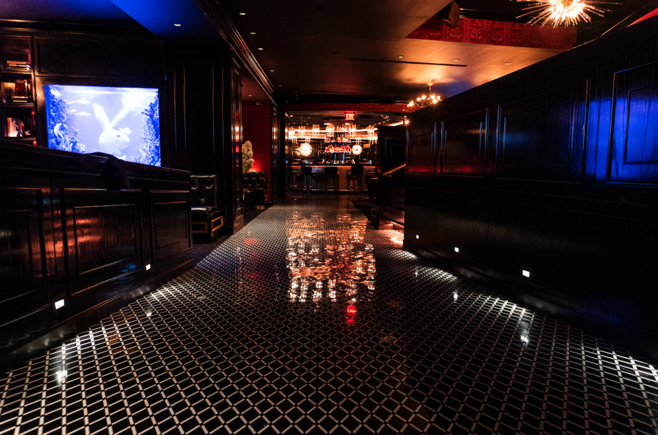 Diamond patterned tile flooring in the lounge area of the Playboy Club in New York City. MEP services provided by 2L Engineering.
