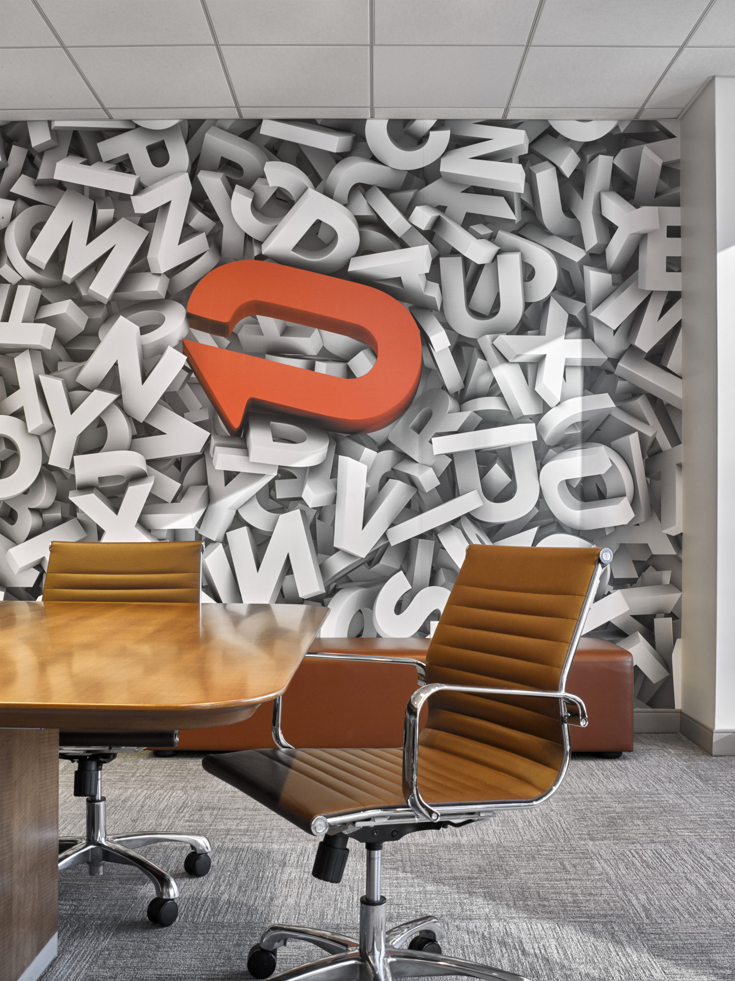 3D wallpaper with the Padilla CRT logo in a conference room at Padilla CRT, New York. MEP provided by 2L Engineering.