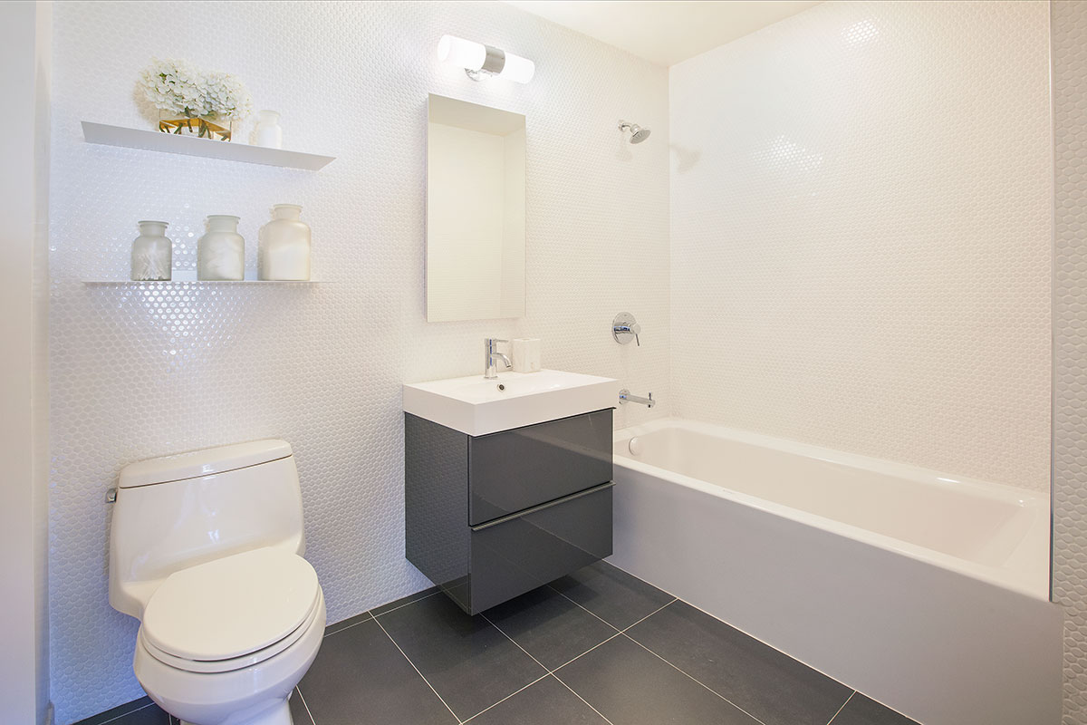 The bathroom of an apartment at The Lefferts House at 195 Hawthorne Street with MEP-FP engineering services provided by 2L Engineering