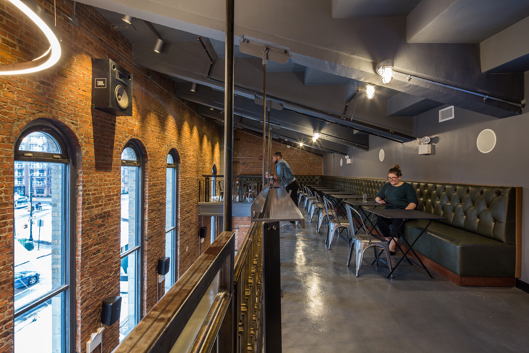 Upper level of the exposed brick interior of the Nitehawk Cinema at 188 Prospect Park West in Brooklyn, with MEP-FP engineering services provided by 2L Engineering.