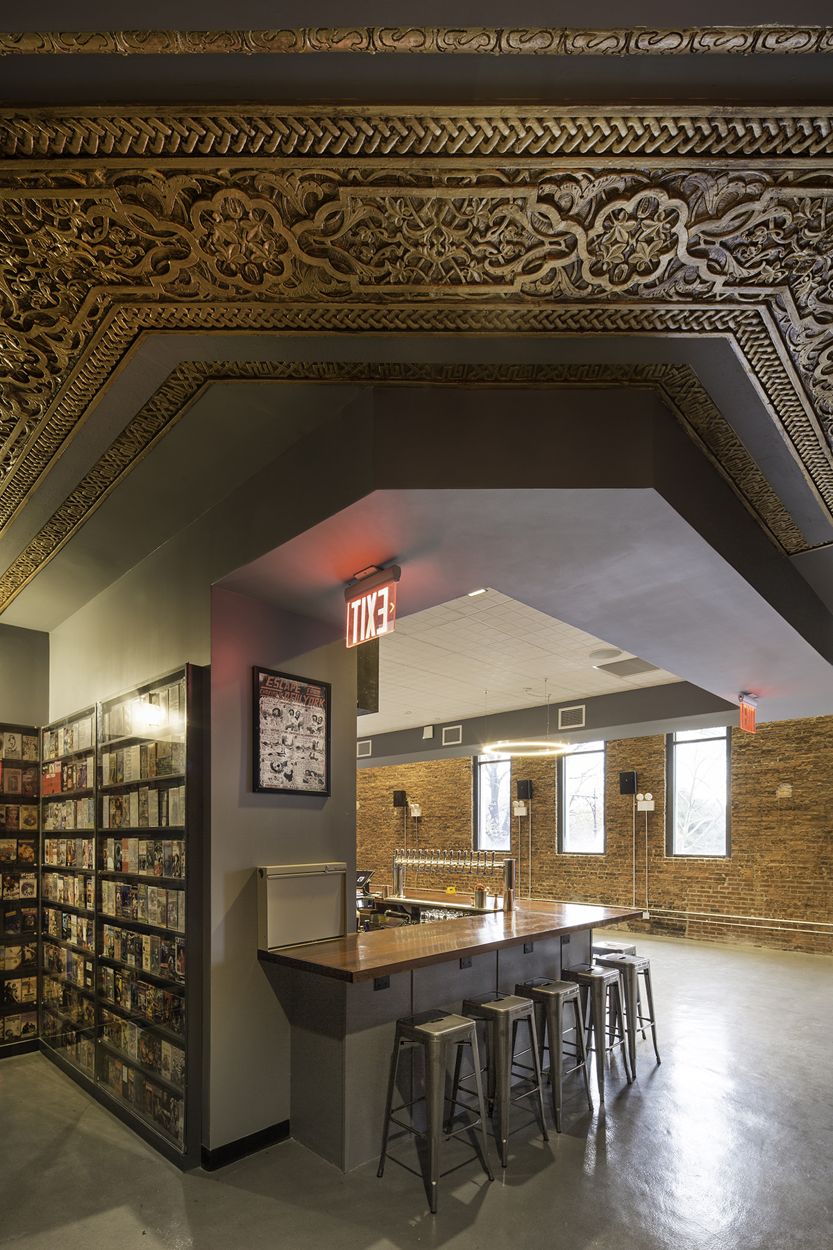 The bar and interior architecture of the Nitehawk Cinema at 188 Prospect Park West in Brooklyn with MEP-FP engineering services provided by 2L Engineering.