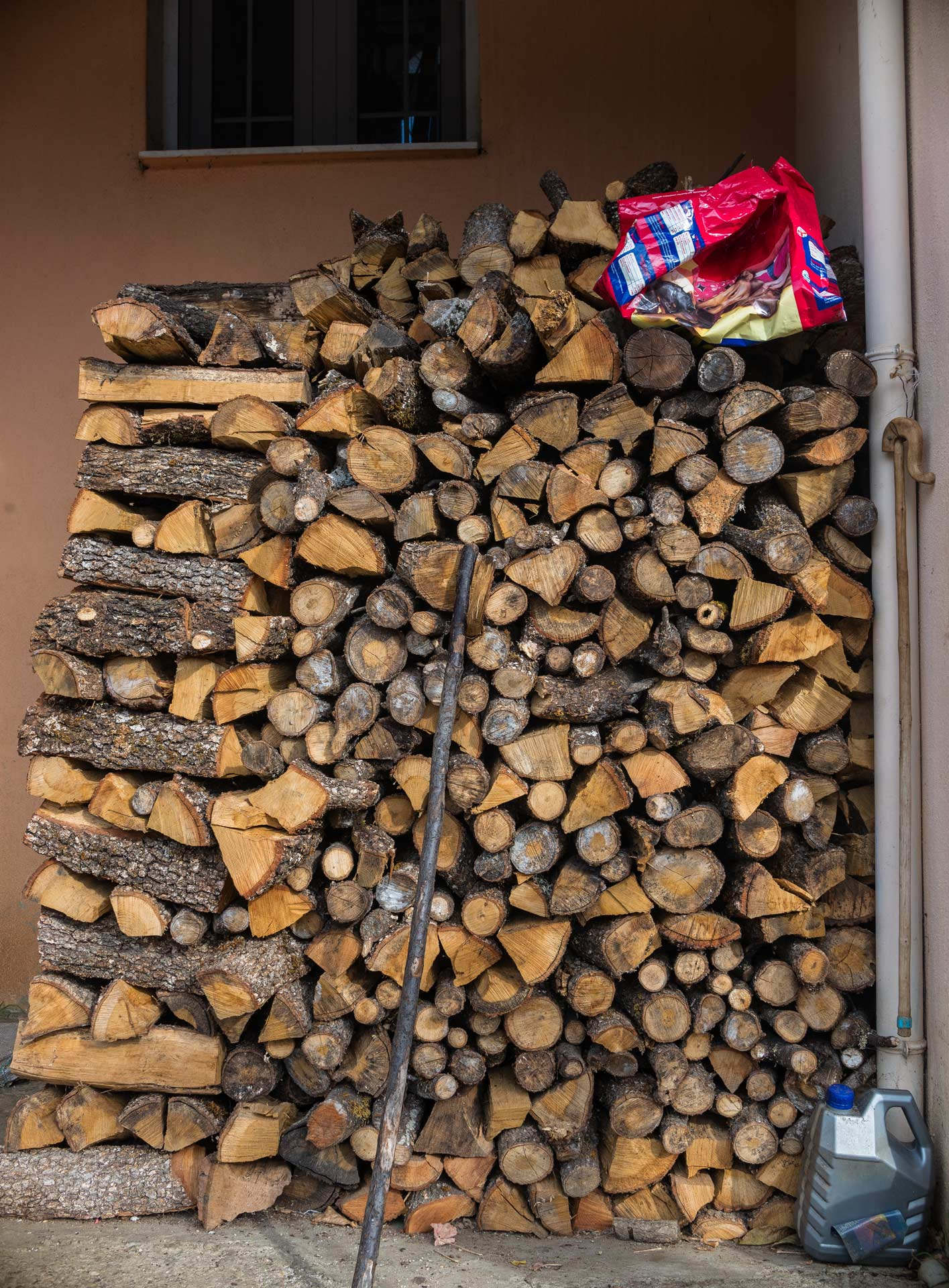 Wood, stored for burning through the cold winter that is about to come.