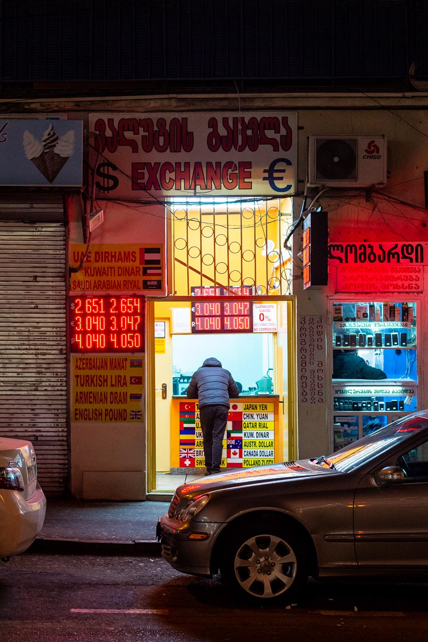A man at a currency exchange shop.
