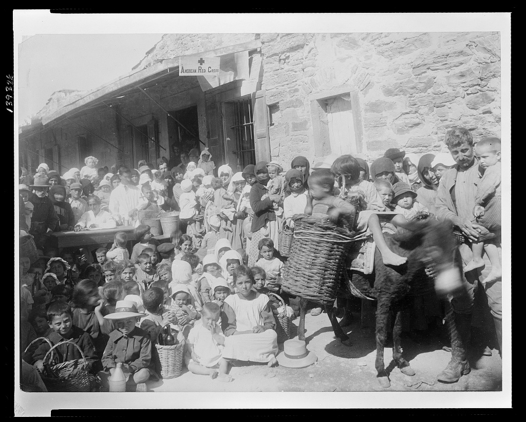 """The ARC by dint of sheer persistence, succeeded in establishing feeding, medical and sanitary centers in the heart of the mountains, where many refugees had wondered [i.e. wandered] Even the Greek government itself had not reached these people for months after the R.C. had catalogued and was feeding them. The above picture shows the baby milk feeding station at the village of Thimiana, on the Isle of Chios, which is the center of that section of the island."" Text and image courtesy of Library of Congress."