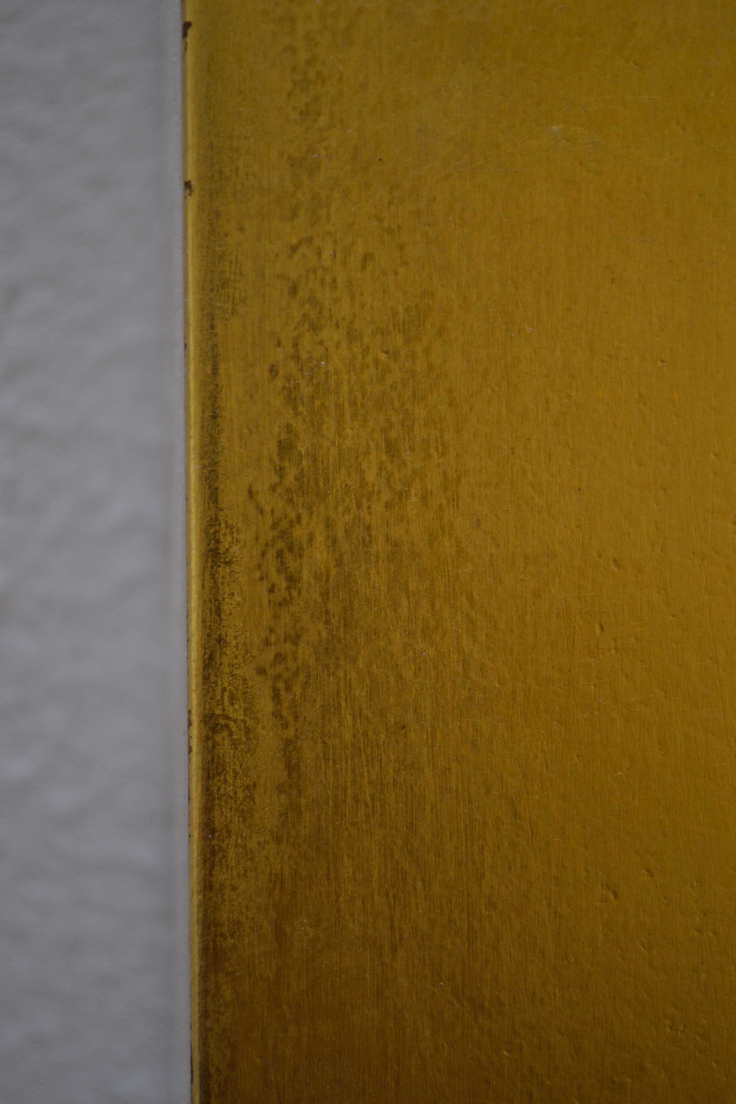 Gilding detail, edge of gilded panel. Dark areas are degraded varnish.