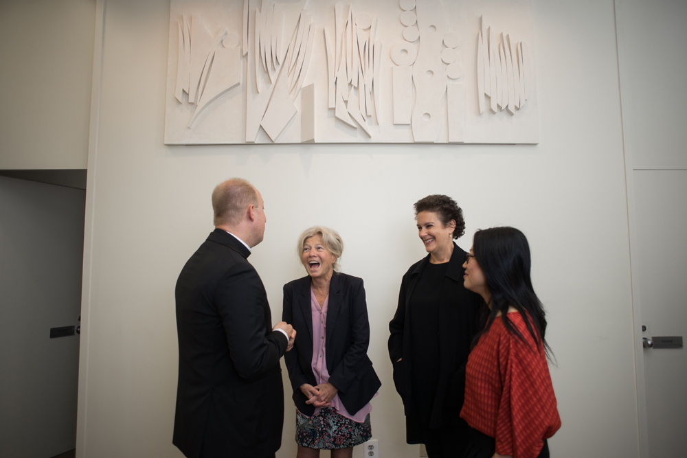 Pr. Jared Stahler and panelists (Alice Aycock, Brooke Kamin Rapaport and Jean Shin) standing below Grapes and Wheat Lintel from Nevelson Chapel)