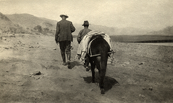 Rev. Watts O. Pye strides up a desert trail in Northwest China, around 1925. This photo helped inspire the ending for River of Dust and the overall sense in both novels that these Americans were pioneers in a rugged landscape that resembled our American West.