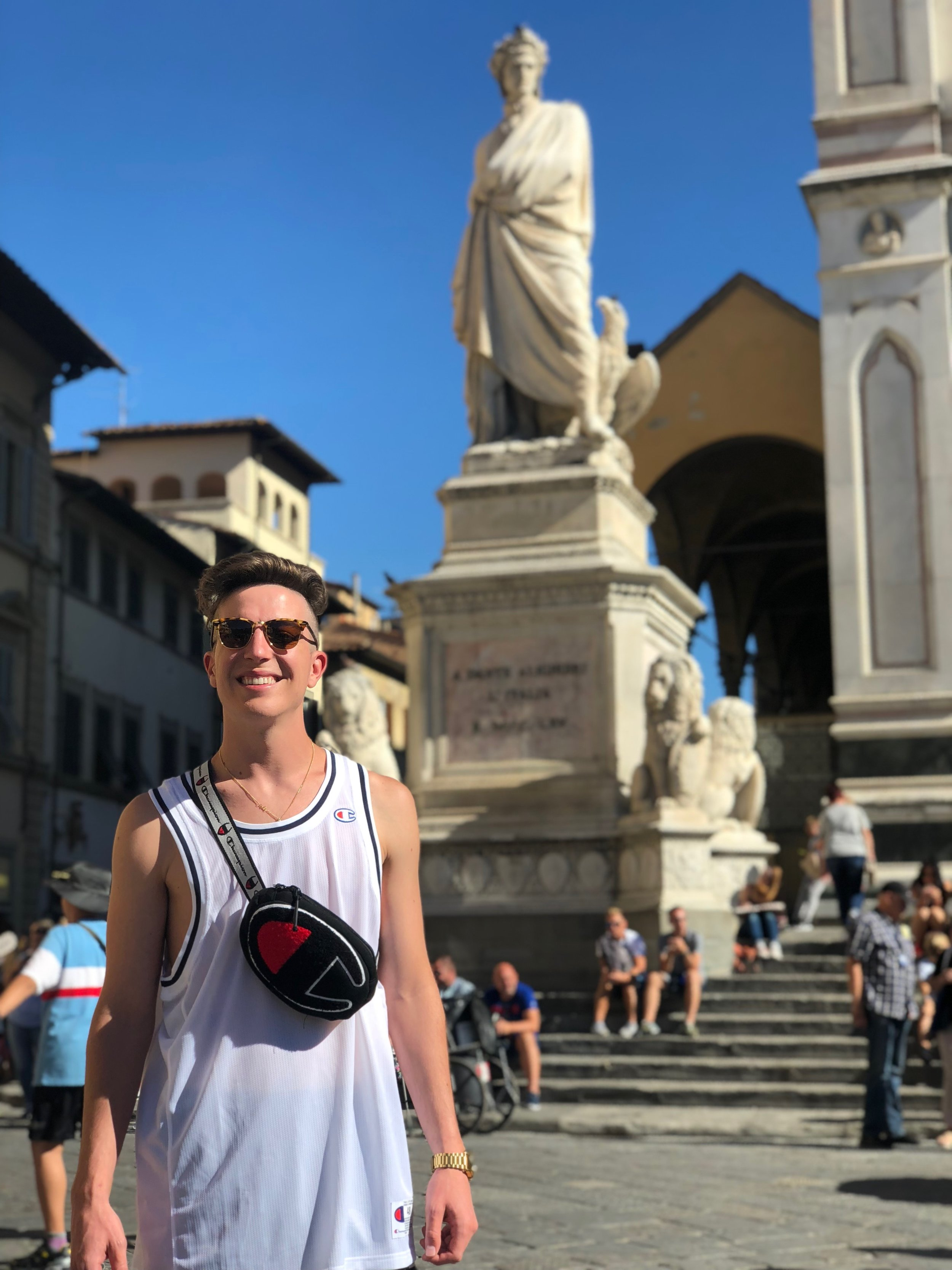 Louie with the statue of Dante outside of the Santa Croce Church