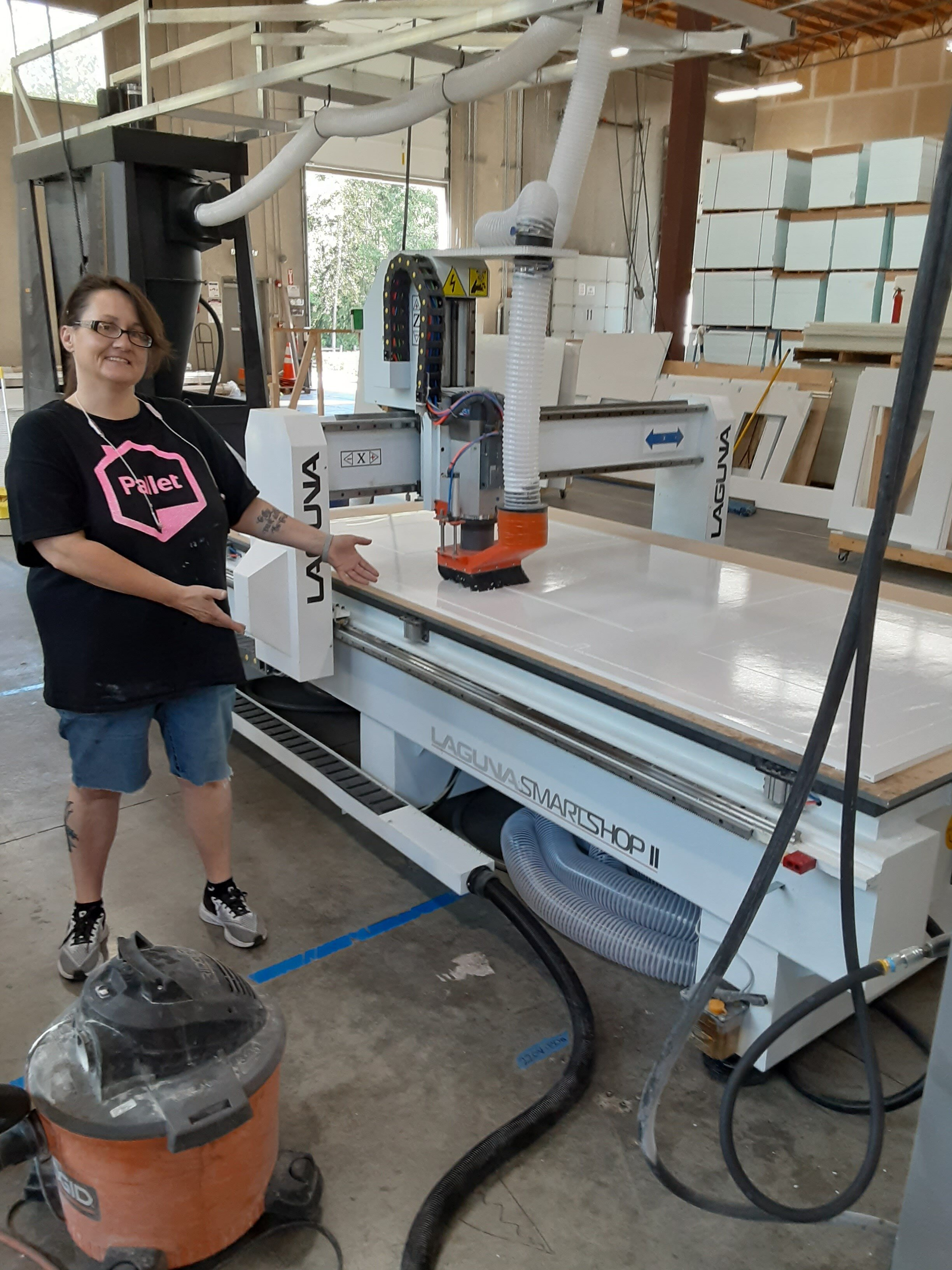 Daniece after learning how to use new manufacturing equipment at Pallet's factory headquarters.