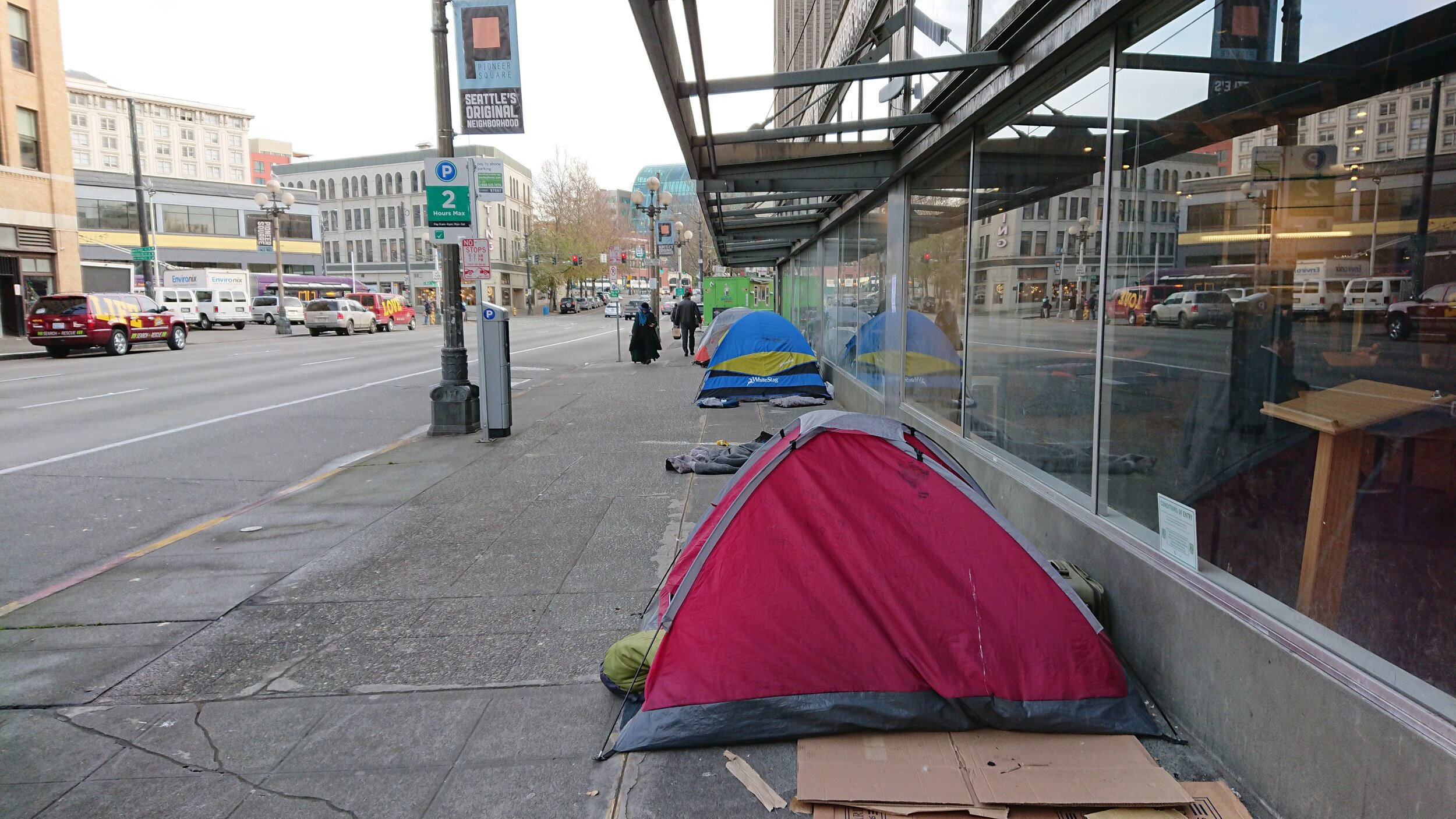 Tents line a sidewalk in Seattle's Pioneer Square neighborhood.  In 2020 Washington state experienced a 20 percent increase in homelessness among families with children. File photo.