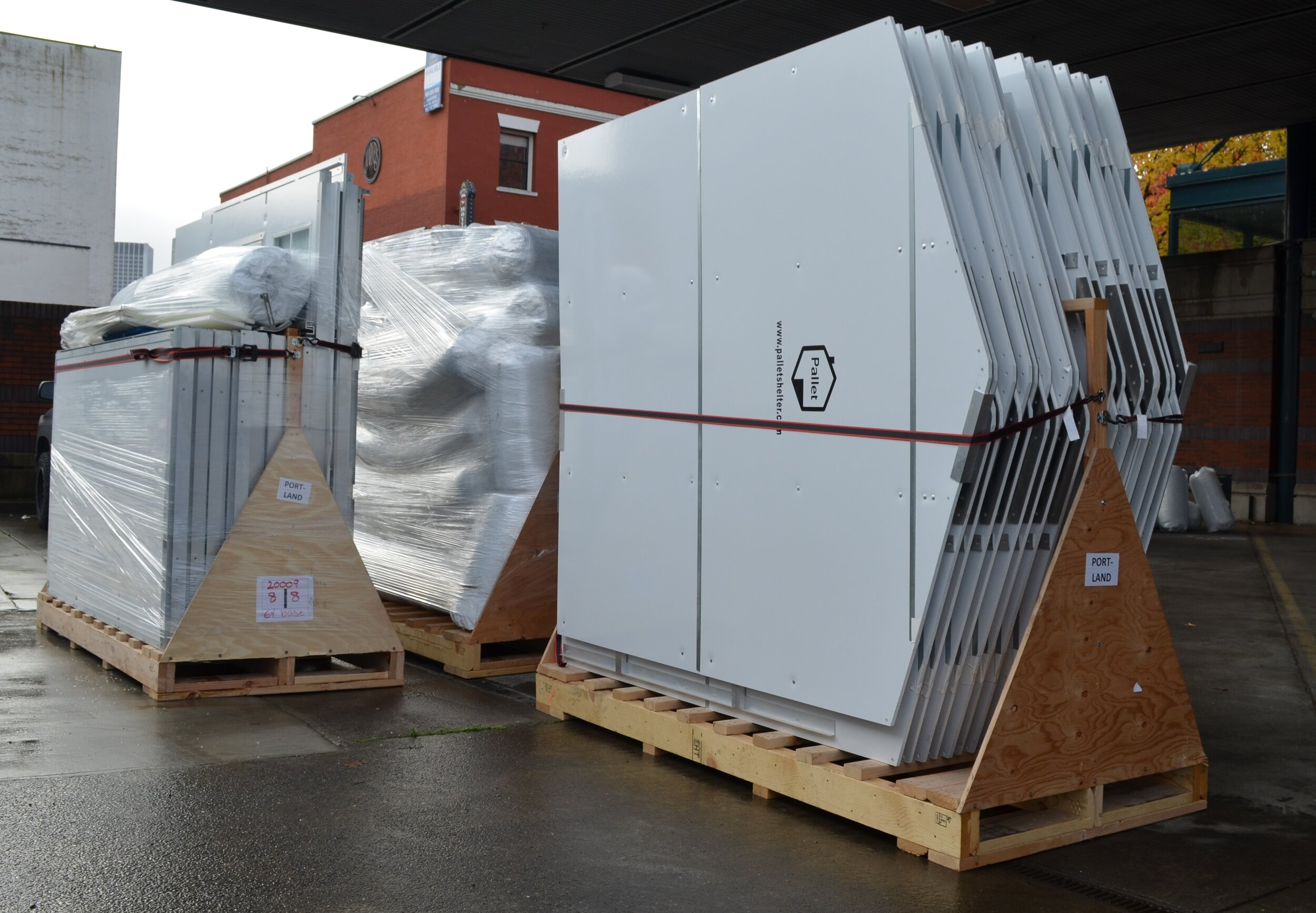 Pallet shelters panels are shipped on pallets. In this photo, the shelters are being unloaded in Portland, Oregon.