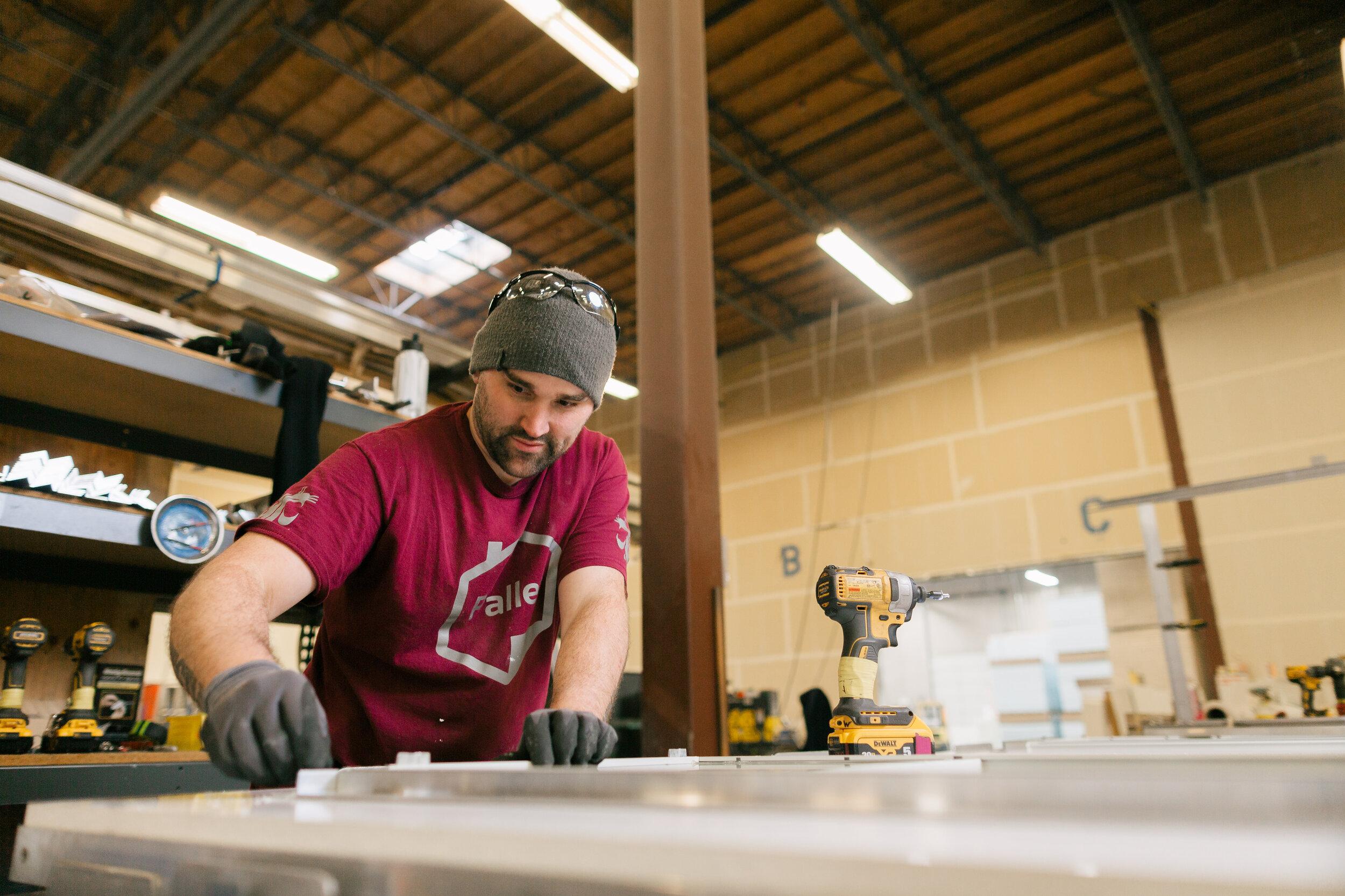 Josh works on a Pallet shelter. Photo by Joe Tobiason