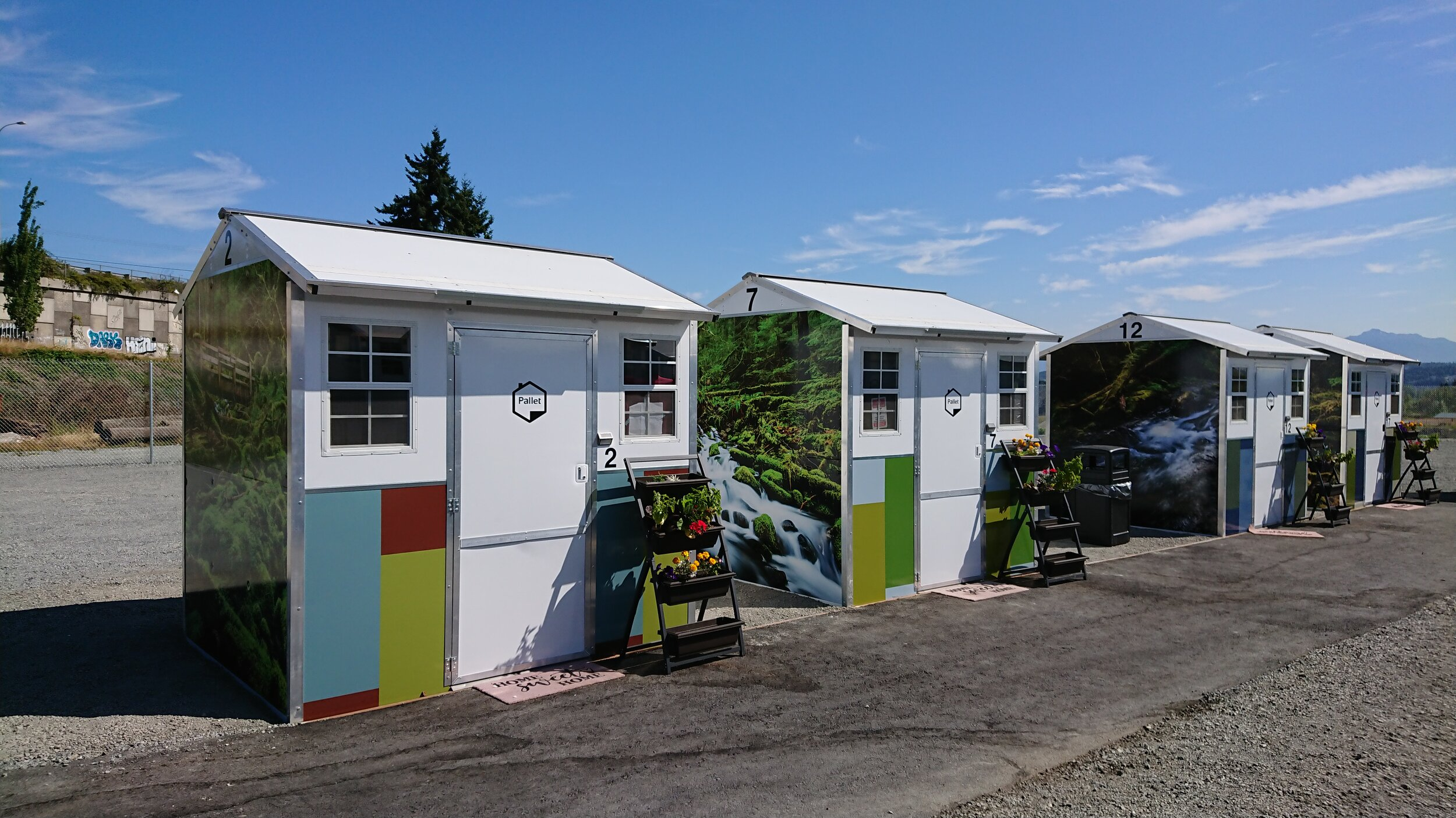 After opening, Everett Gospel Mission decided to spruce up the look of the shelters with scenes from the Pacific Northwest. They hired a local company to complete the vinyl wrapping.