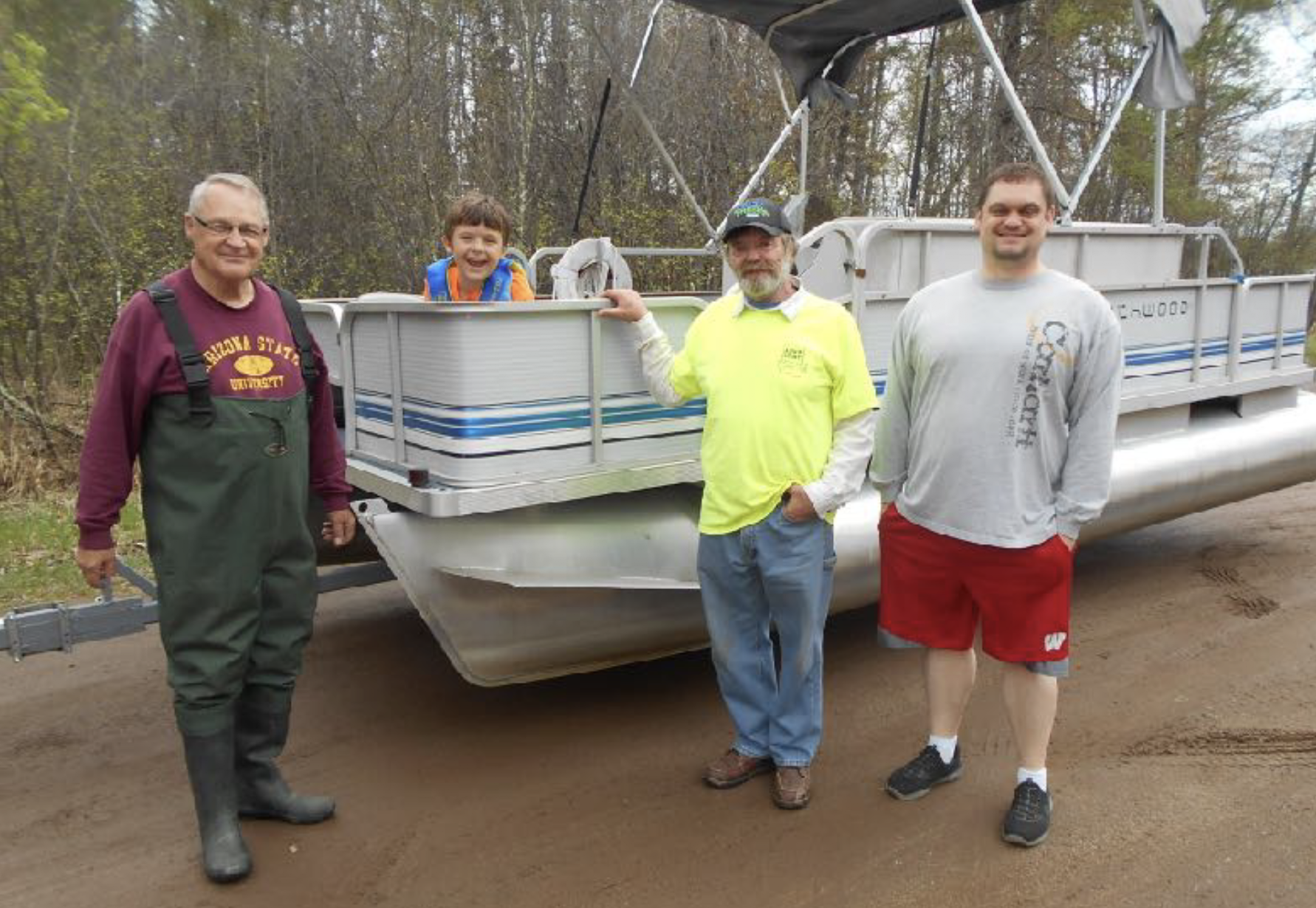 Dick Preiner and family members (Lot 90) launched his pontoon over Memorial Day Weekend. Our weekend's AIS Inspector (in yellow) said most of the Memorial Weekend inspections were of boats that are permanently on Lone Lake, typically not an AIS threat.