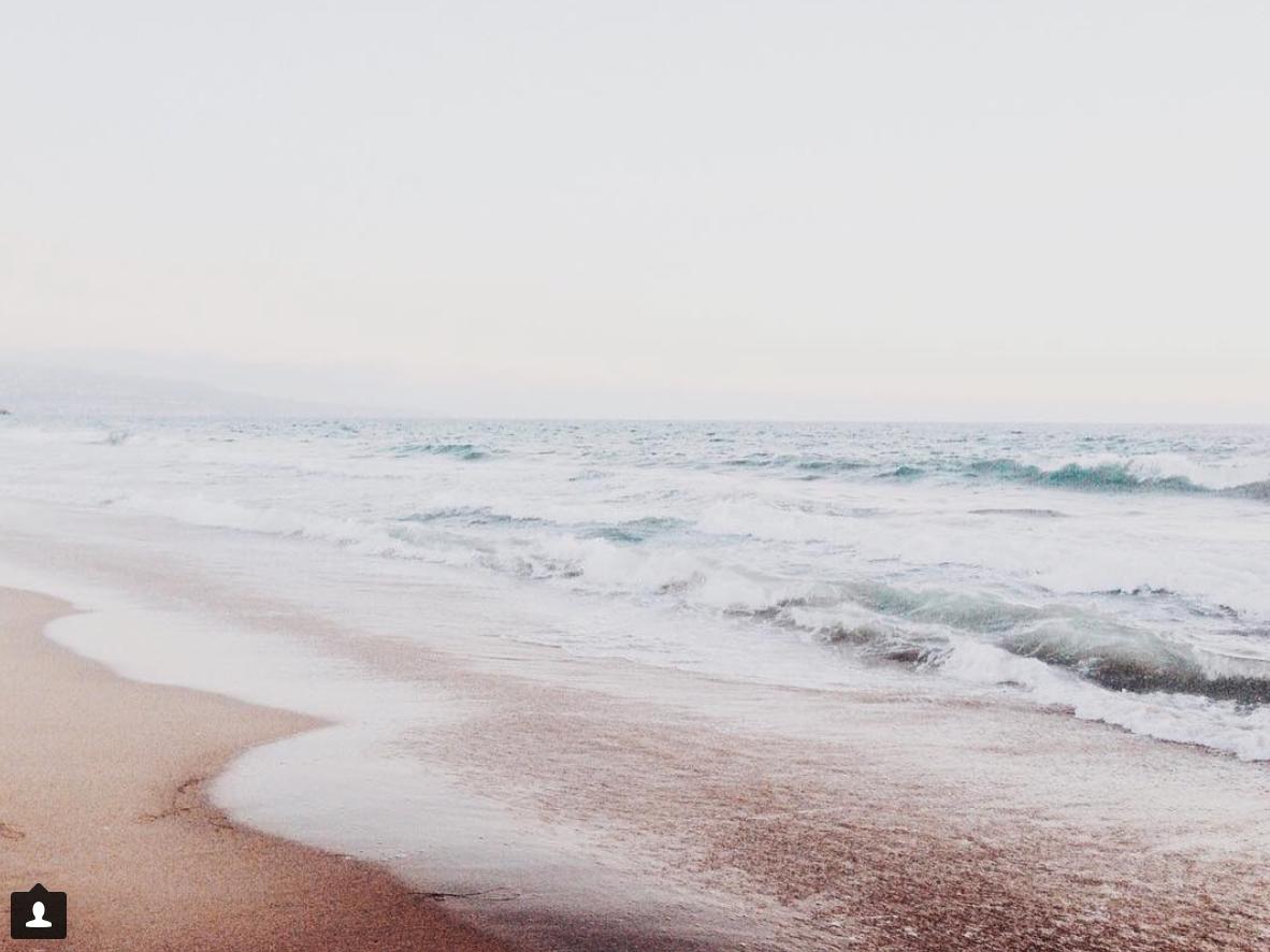 Foamy Surf on Sand