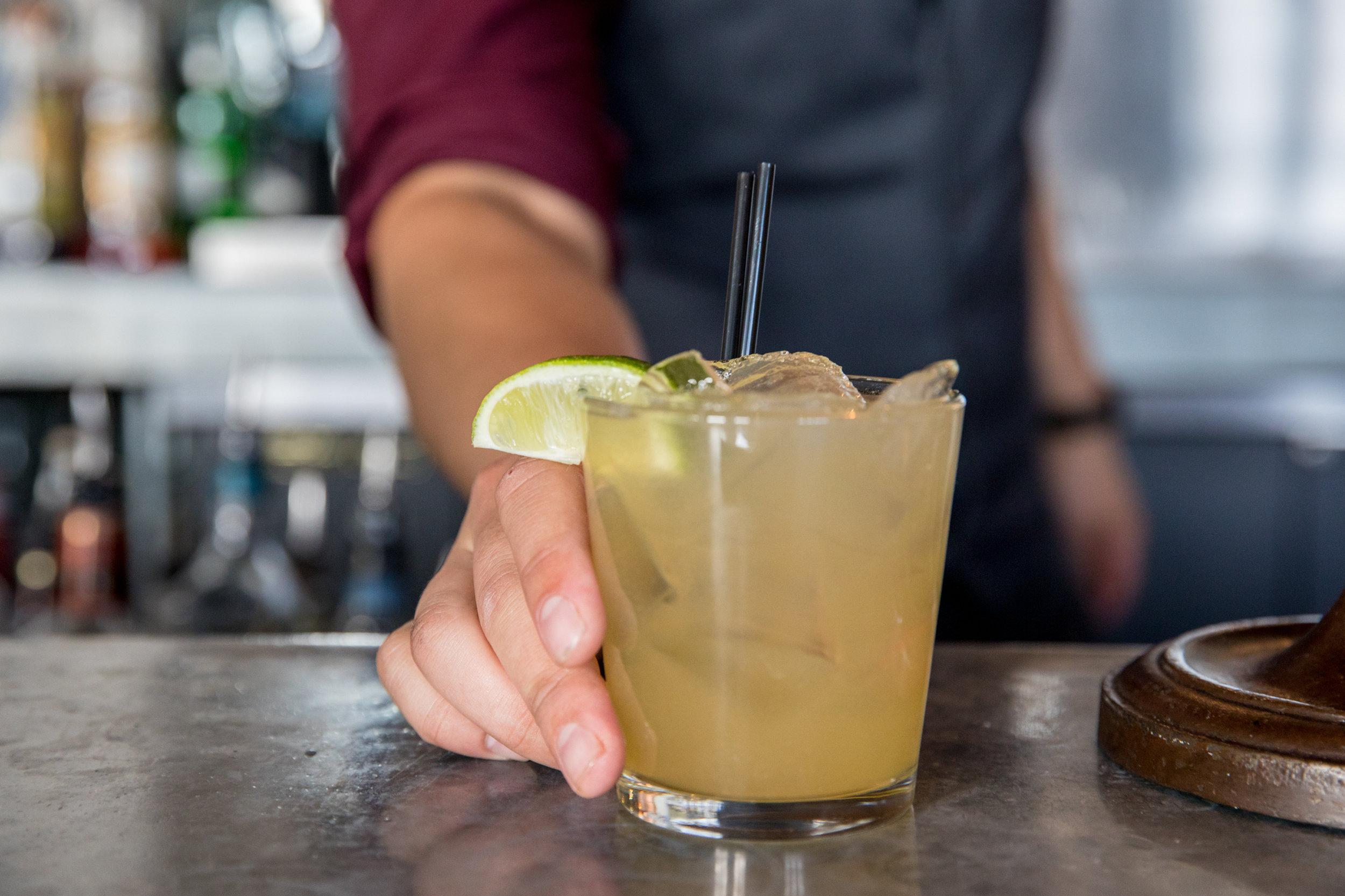 Bartender Offering Drink at Alta House