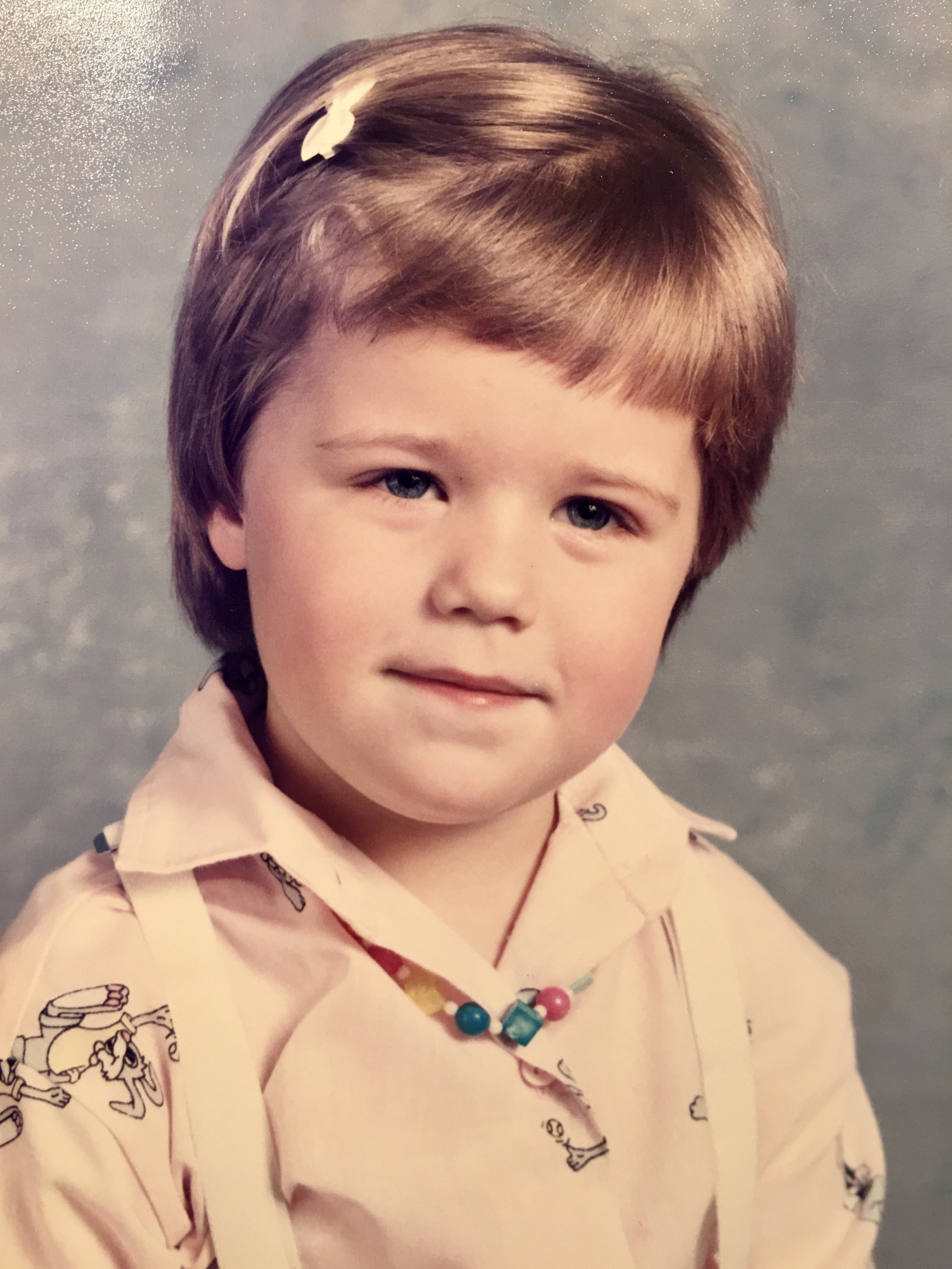 This is my favorite picture of little me. The small barrette, the necklace, the suspenders. Feels very put together.