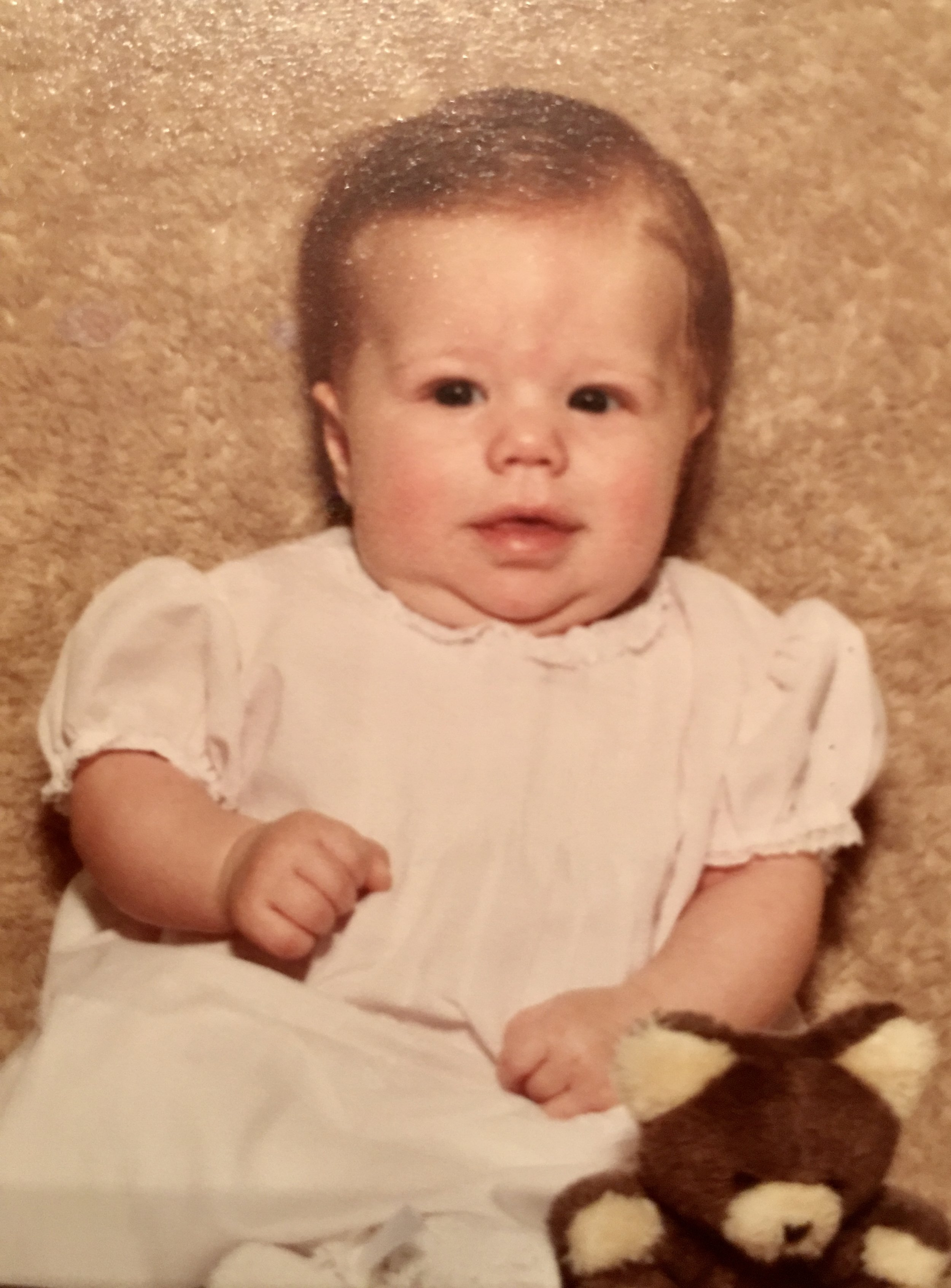 I'm probably 3 months or so here. As you can see, I was born with plenty of hair.