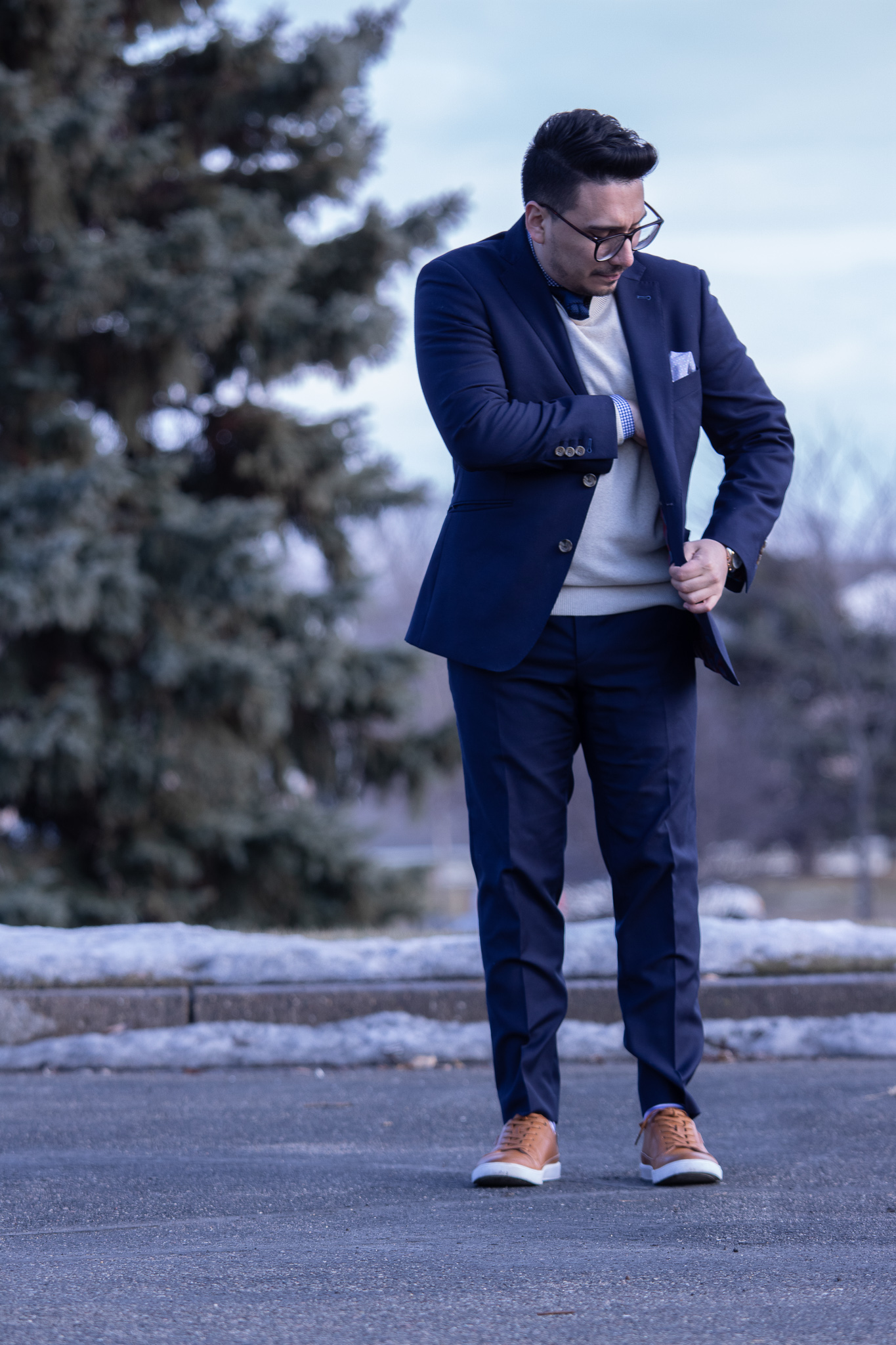 navy suit with brown sneakers