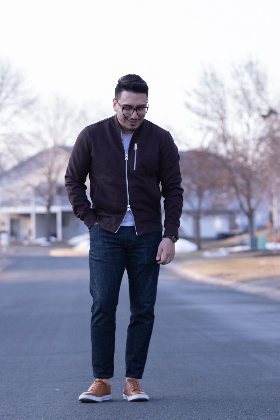 bomber jacket with jeans and brown leather sneakers