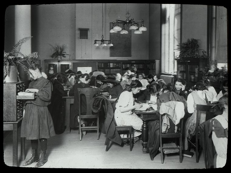 A beautiful expression of early 20th-century American interior architecture. The lighting, the indoor plants, the wood carvings are all so perfect. Source: New York Public Library.  Tompkins Square,girl at card catalog, ca. 1910.