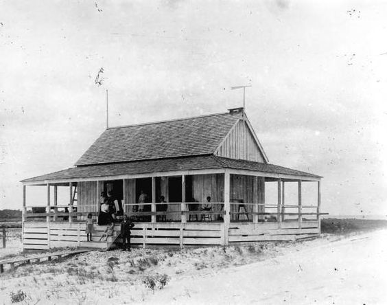 Gathering on the porch at the home of  Edward G. Porter on Saint George Island, Florida. The home was designed to keep cool, with an elevated foundation and a large, un-obstructed, wrap-around porch. A good example of a typical cracker ranch house constructed in the late 1800's.