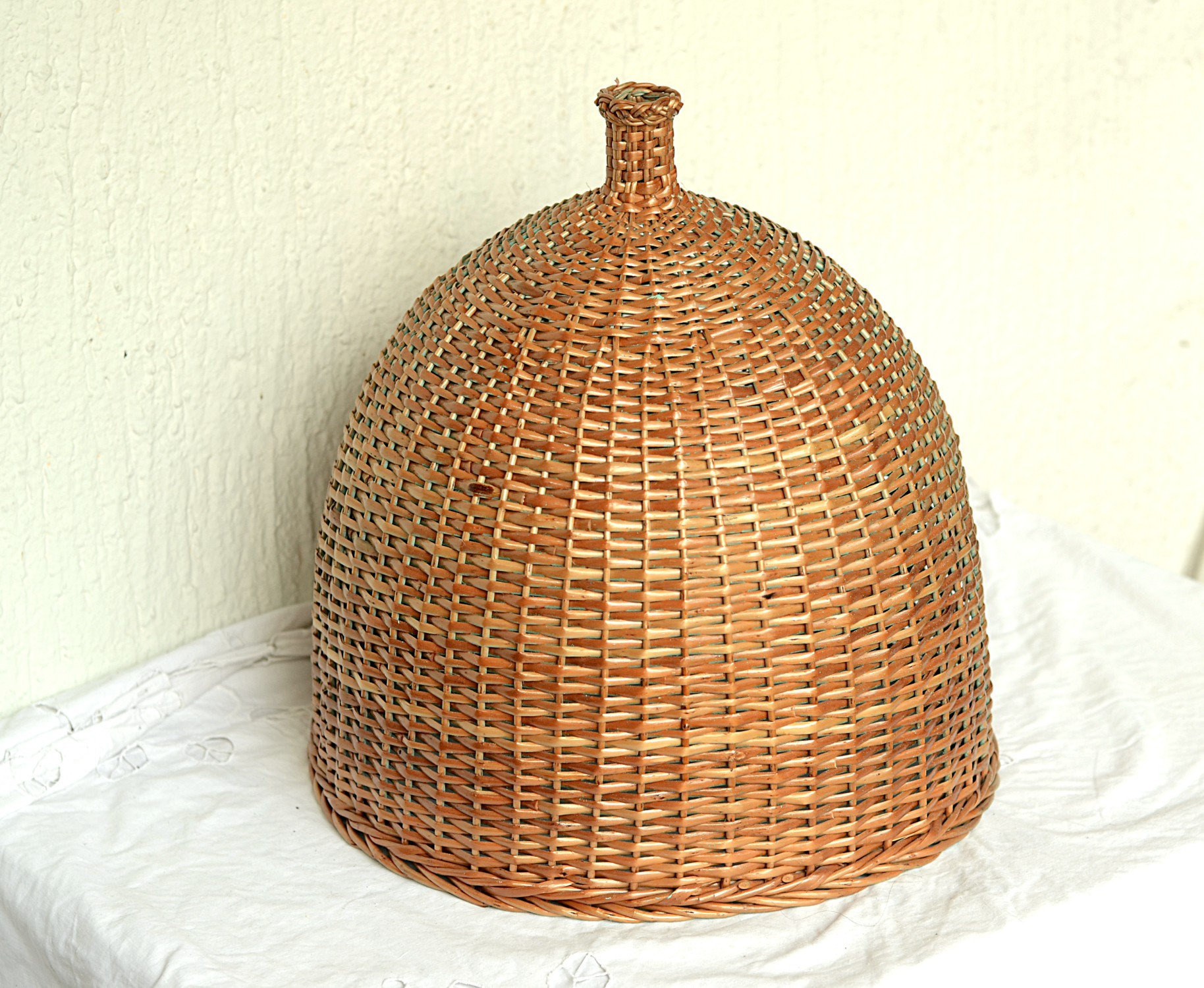 A made-to-order, tight-knit Wicker Shade from Willow Souvenir on Etsy. - $58 and up. Made in Bosnia.