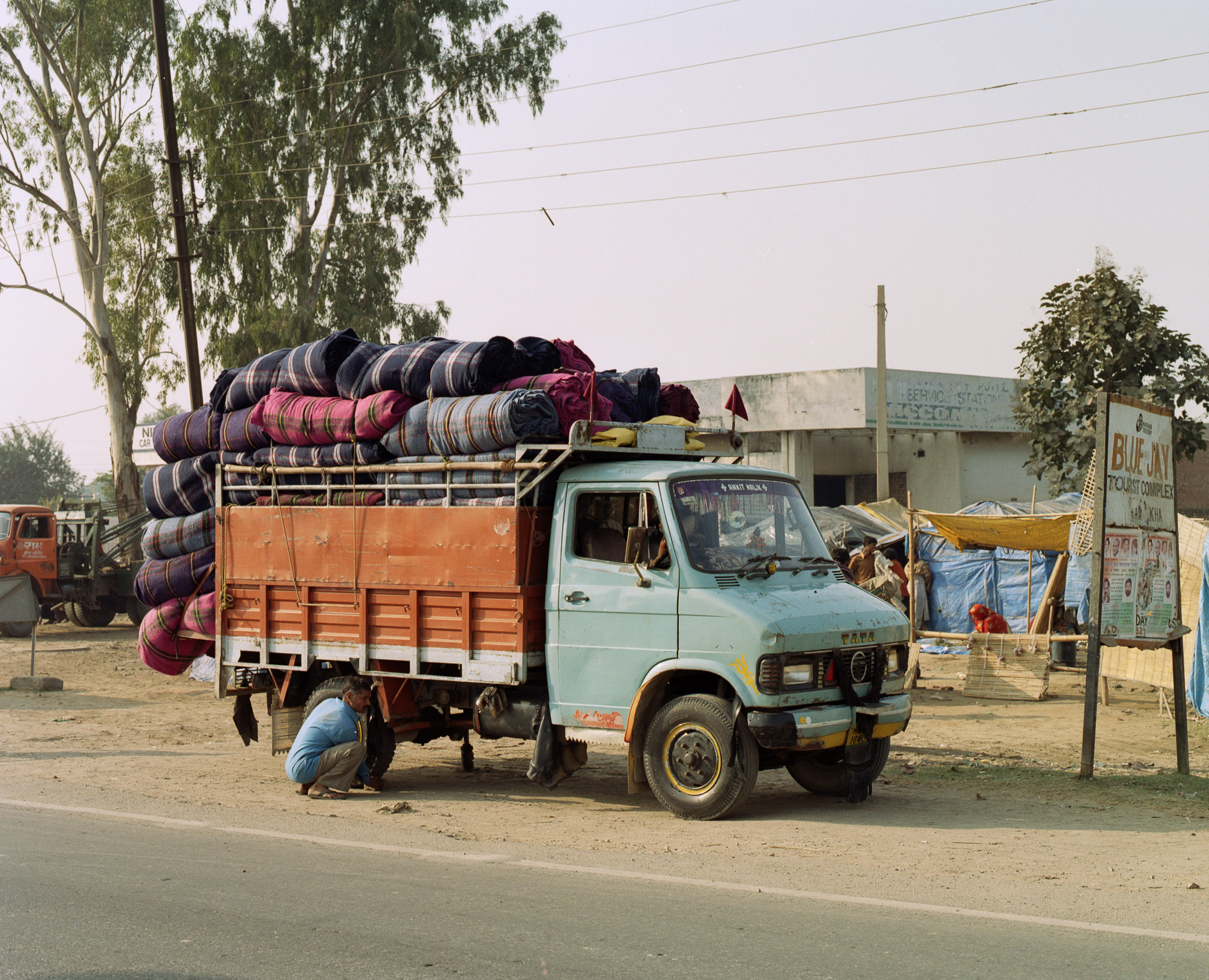 The less pure coloured, poorer quality shoddy blankets leave Panipat destined for the aid industries and the army.
