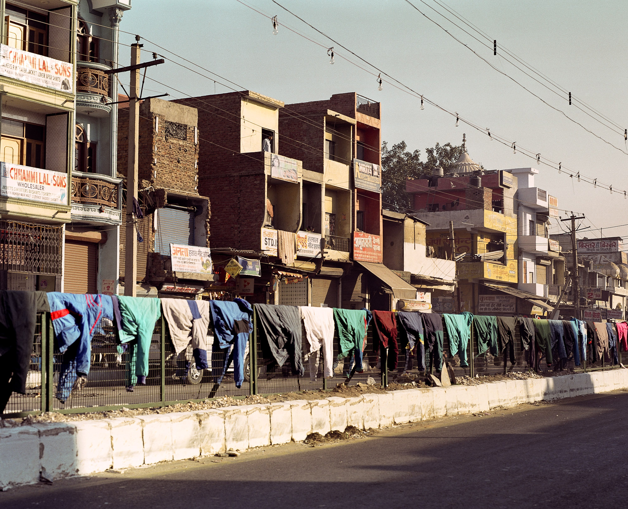 The local area is swathed with drying washing, festooning houses, draping over road barriers and strung across patches of wasteland.
