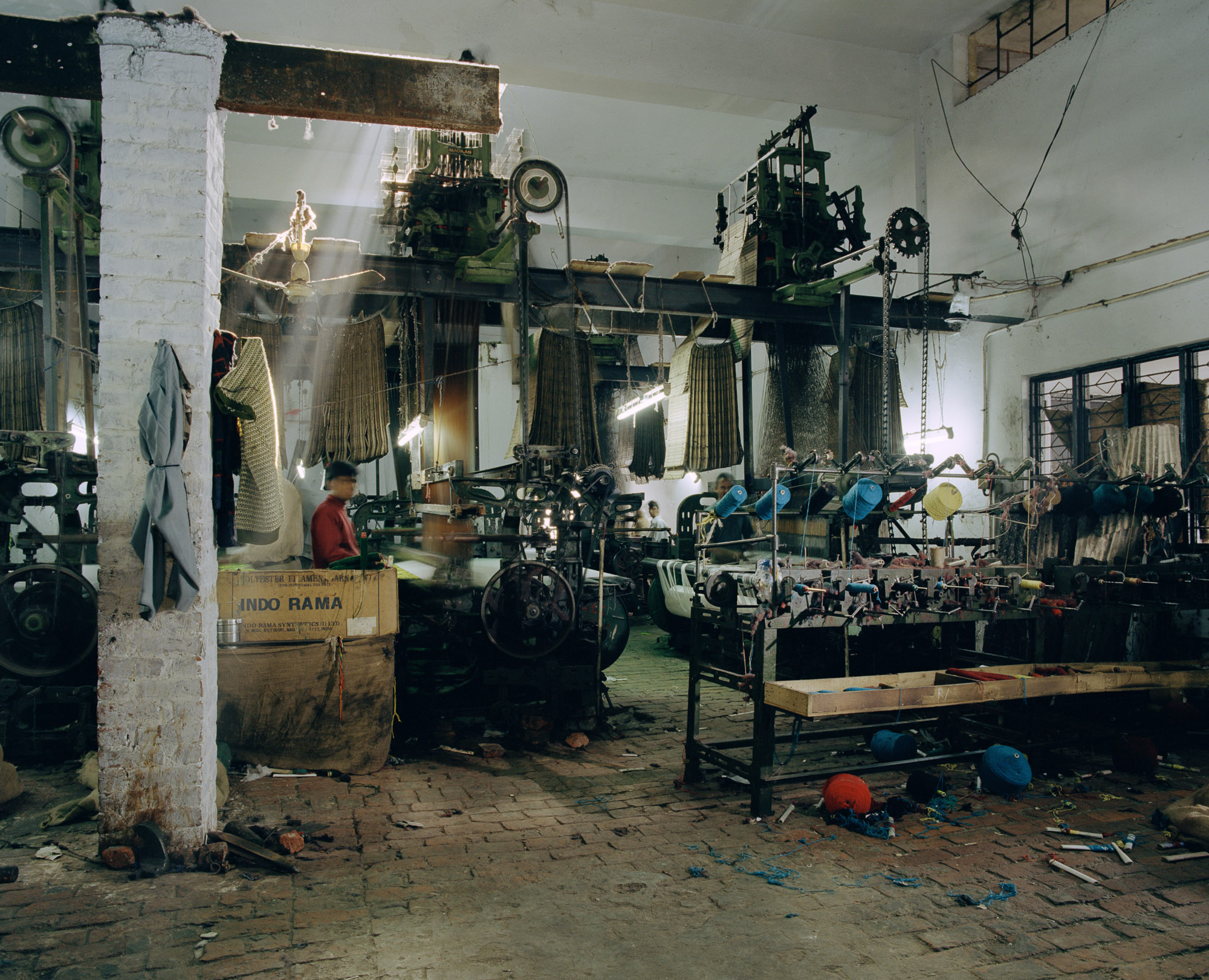 Other factories house heavy old power looms used for weaving shoddy blankets. Shoddy weaving expanded rapidly in the 1980s, using machinery imported from Italy and Poland.