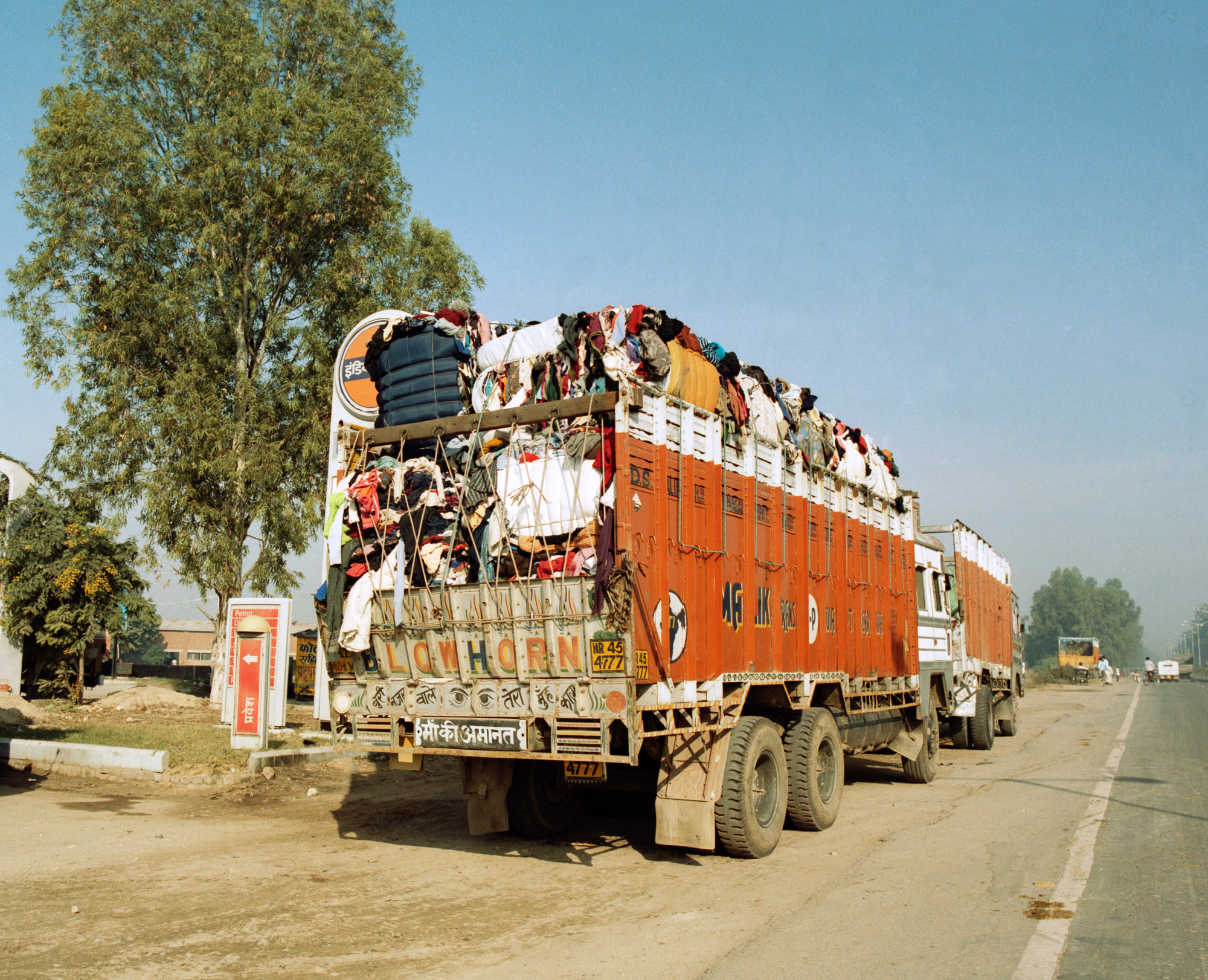 Over 100,000 tonnes of used clothing  is imported into India every year for recycling. Every day, truck loads of imported clothing bales are driven from India's ports up the Grand Trunk Road to Panipat, north of Delhi.