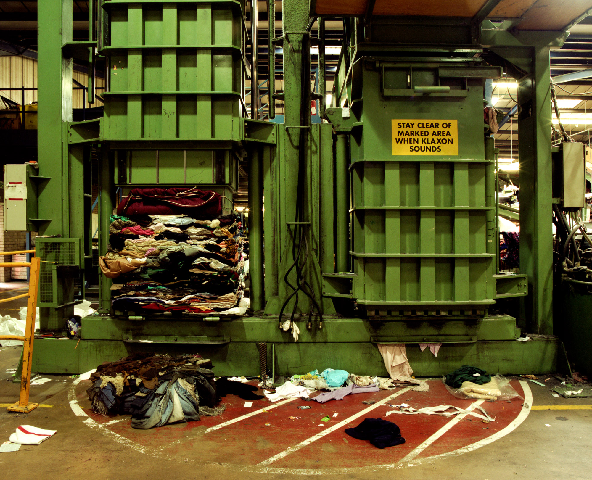 The sorted clothing is then compressed into bales weighing up to 2 tons, ready for transportation around the globe.