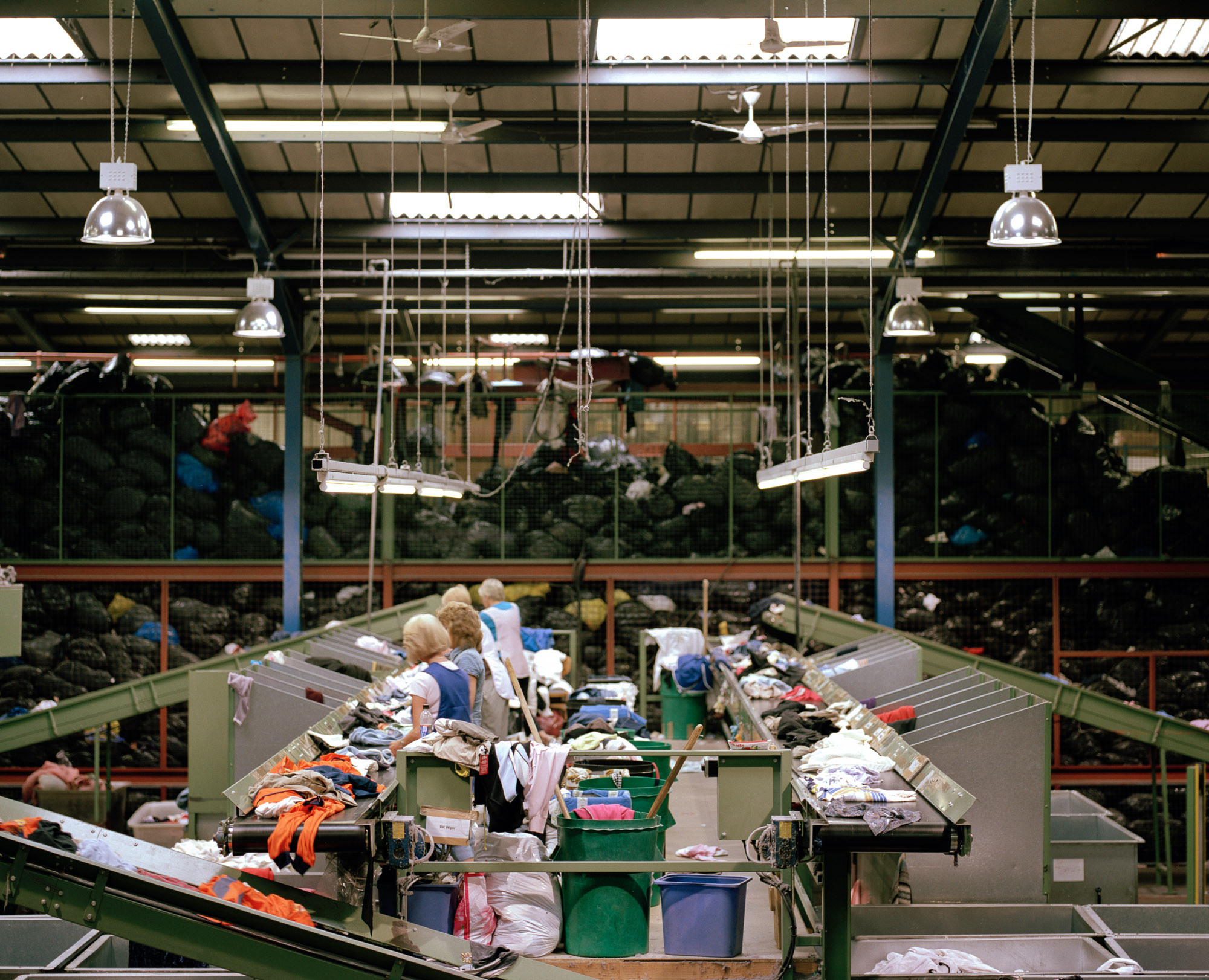 Meanwhile, a textiles recycling depot in Yorkshire collects clothing donated from all over the country. Mountains of black plastic bags are split open and their contents sorted on conveyor belts.