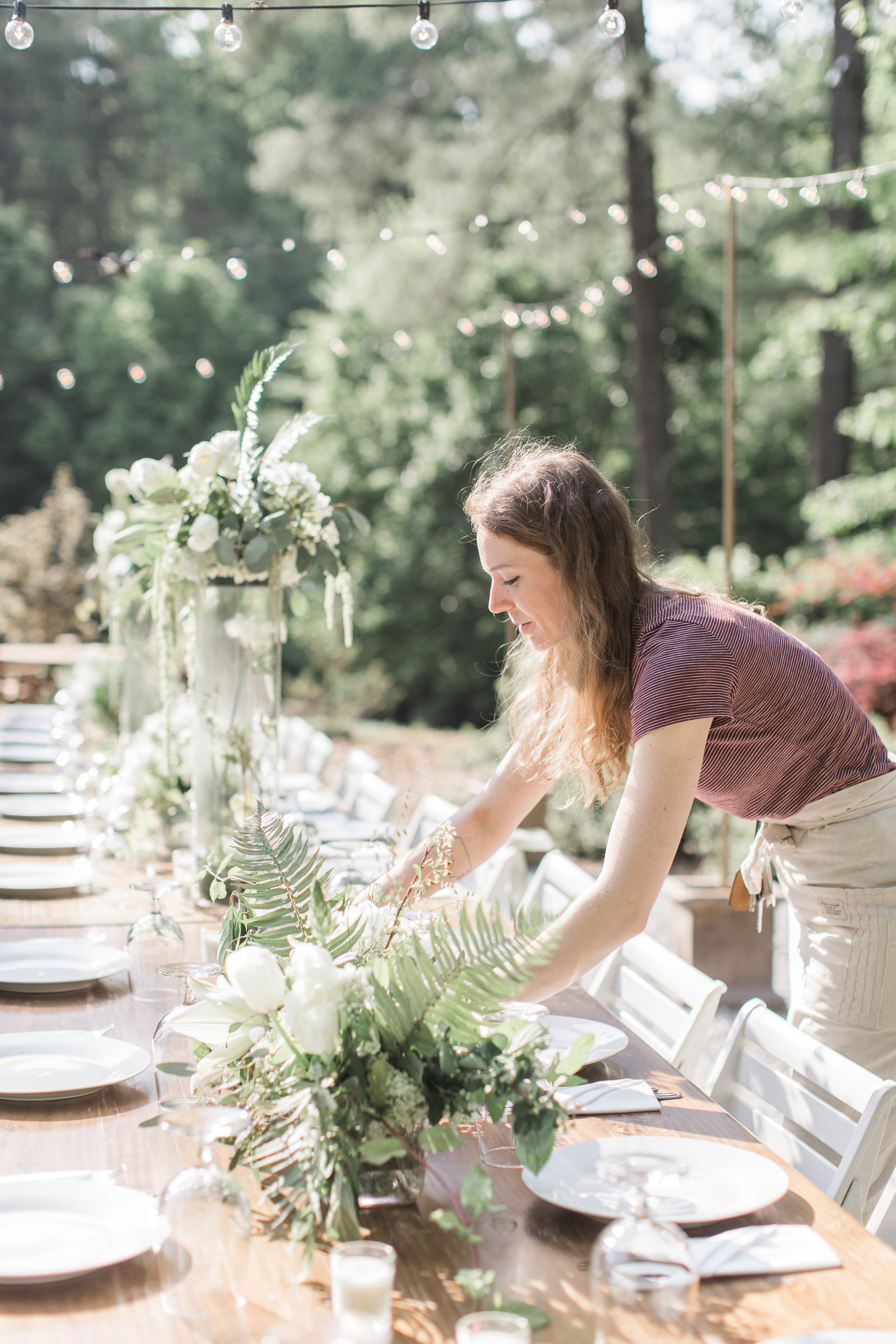 Welcome! I'm Madelaine... - I'm the owner and designer at Mood Fleuriste. My flowers and I travel throughout North Carolina and North Georgia to bring joy and wonder to the wonderful people I work with!I got started working with flowers when my event-planner mom, a real-life version of Leslie Knope, called upon me to help at a wedding that got too large for the bride to do the flowers DIY. Ever since then we've been working together to create beautiful events for our clients in North Georgia, and now I'm expanding to the triangle where I live with my husband Derek and dog Bosco.I'm truly an introvert at heart, and flowers allow me to show who I am to the world. I have unmanageably frizzy blondish/reddish/brownish hair which seems to change color depending on my mood, and is part of the name for my business.I love all things Seinfeld, making homemade pasta, playing (and failing) at Mario Brothers with my husband, and just living an honest and gratifying life with the people I love the most.Now that you know a little bit about me, I can't wait to meet you!Thank you immensely to Lindsey LaRue Photography for taking and editing the lovely photo of me at a recent wedding.