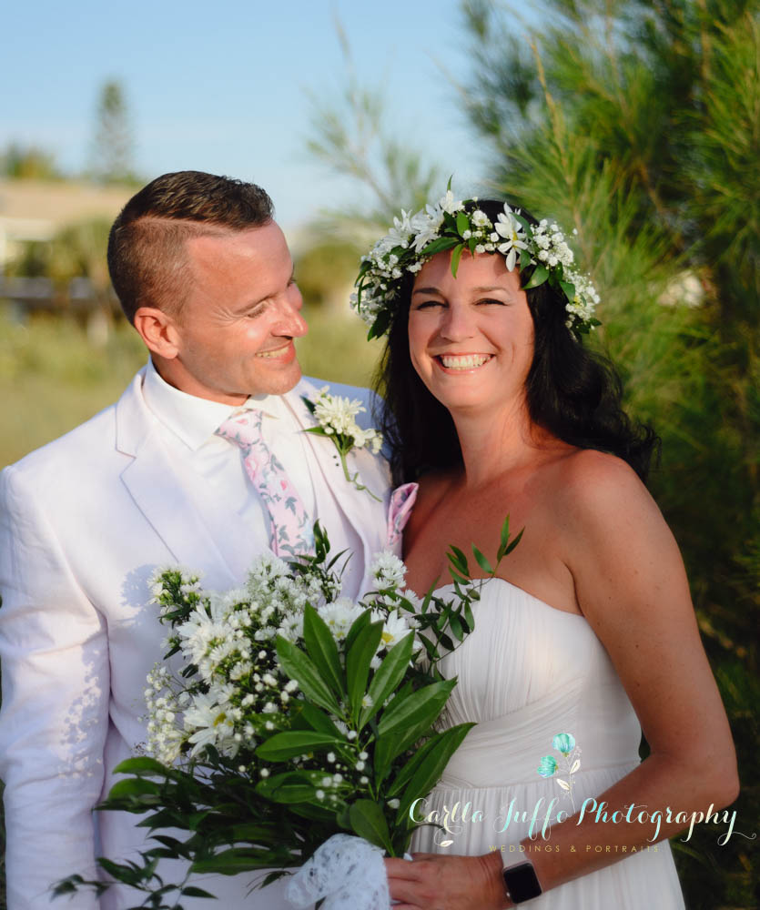 SIESTA KEY WEDDING PACKAGE 1 - STARTS AT $500 - This is our most popular wedding package. Perfect for the modern couple looking to elope on Siesta Key Beach or in one of our Sarasota Gulf Beaches.We offer a simple and meaningful wedding ceremony that includes:Ceremony OfficiantPhotographer - All edited pictures will be sent to client in hi resolution - No extra fees(4) FOUR TIKI TORCHES ADORNED WITH SILK FLOWERS orTWO POLES BAMBOO ARCH ADORNED WITH SHEERS AND SILK FLOWERS
