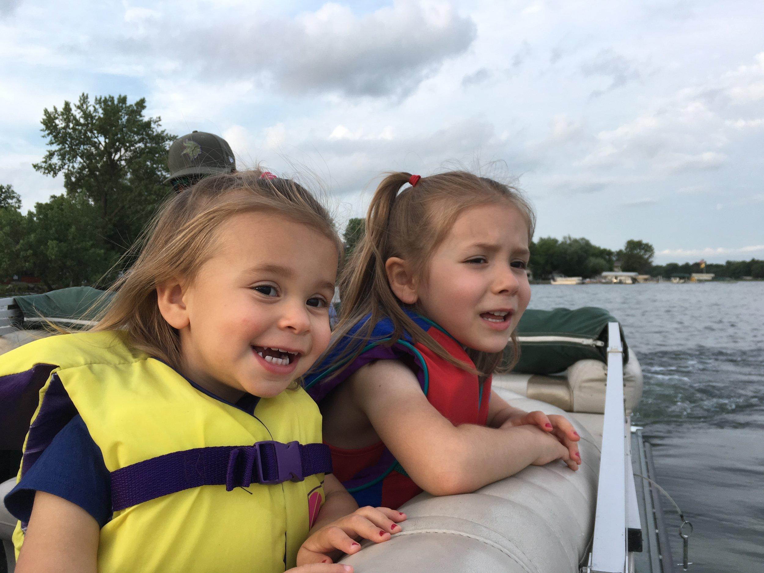 Ella & Sarah watching a jet ski on Lake Darling in Alexandria