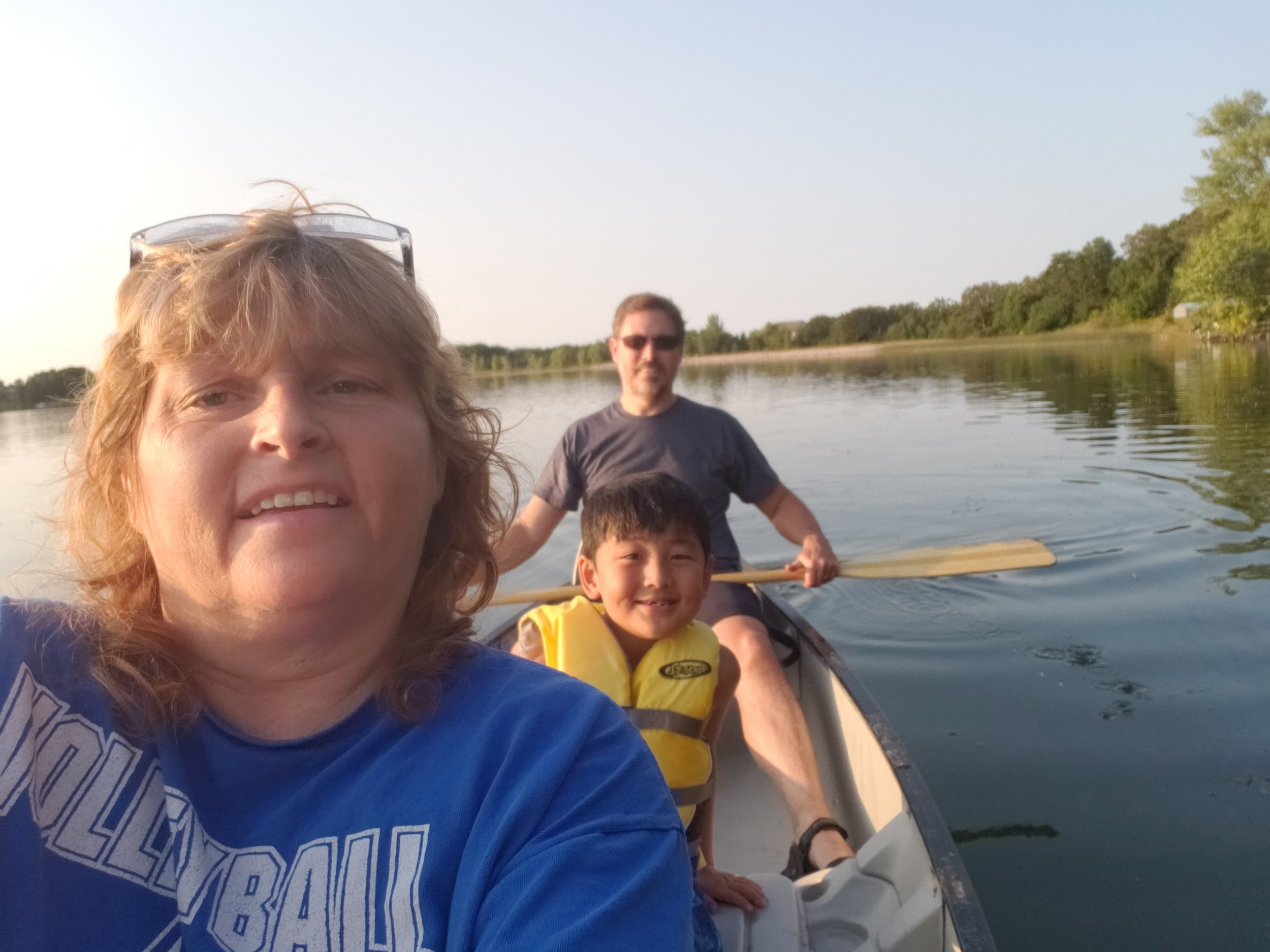 Todd takes up the back of the canoe as the rest of his family enjoys this summer lake adventure.