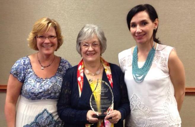 Darlene and her award.jpg