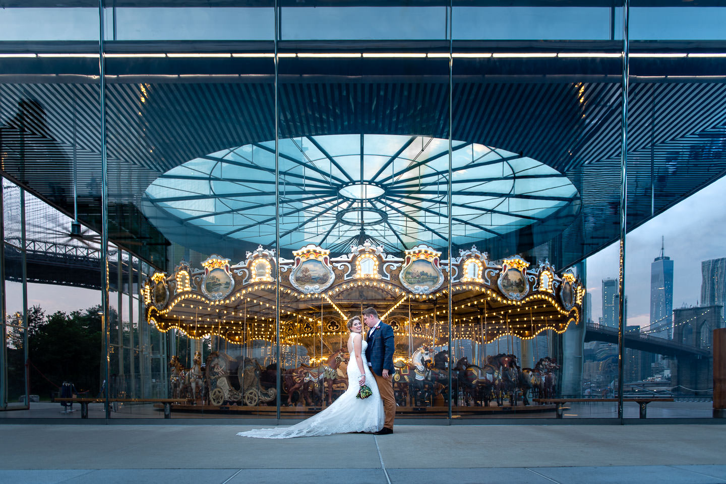 bride-and-groom-by-carousel-in-dumbo-brooklyn-at-night.jpg