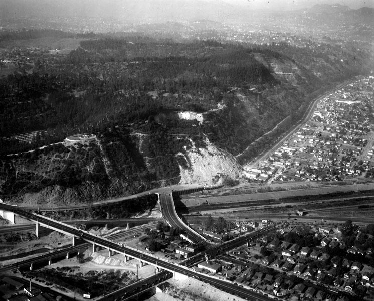 "18. Aerial view of the ""incredible moving mountain"" the morning after its collapse, 1937"